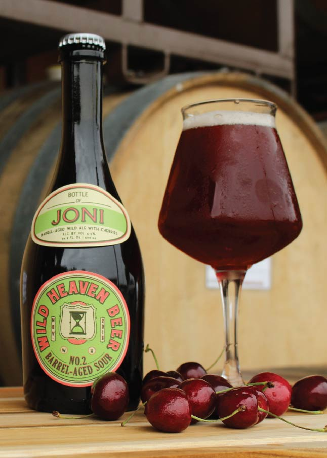Joni - Barrel-aged Sour No. 25.5% ABVThe make Joni, the second in our series of barrel-aged fruited sours, Brewmaster Eric Johnson started with his house golden ale base. It was primary fermented clean in stainless steel before transferred to Bordeaux wine barrels and inoculation with souring bacteria and aged for over a year. 40 pounds of cherries were added to each barrel and aged further. Each barrel produces unique flavor characteristics and only a few were hand-selected to create the tart, light, beautiful final beer, Joni.