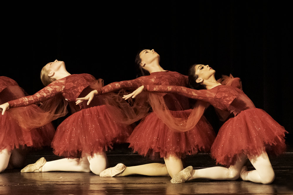 The dancers in red tutus represent the fire of the burning bush encounter that Moses had with God.