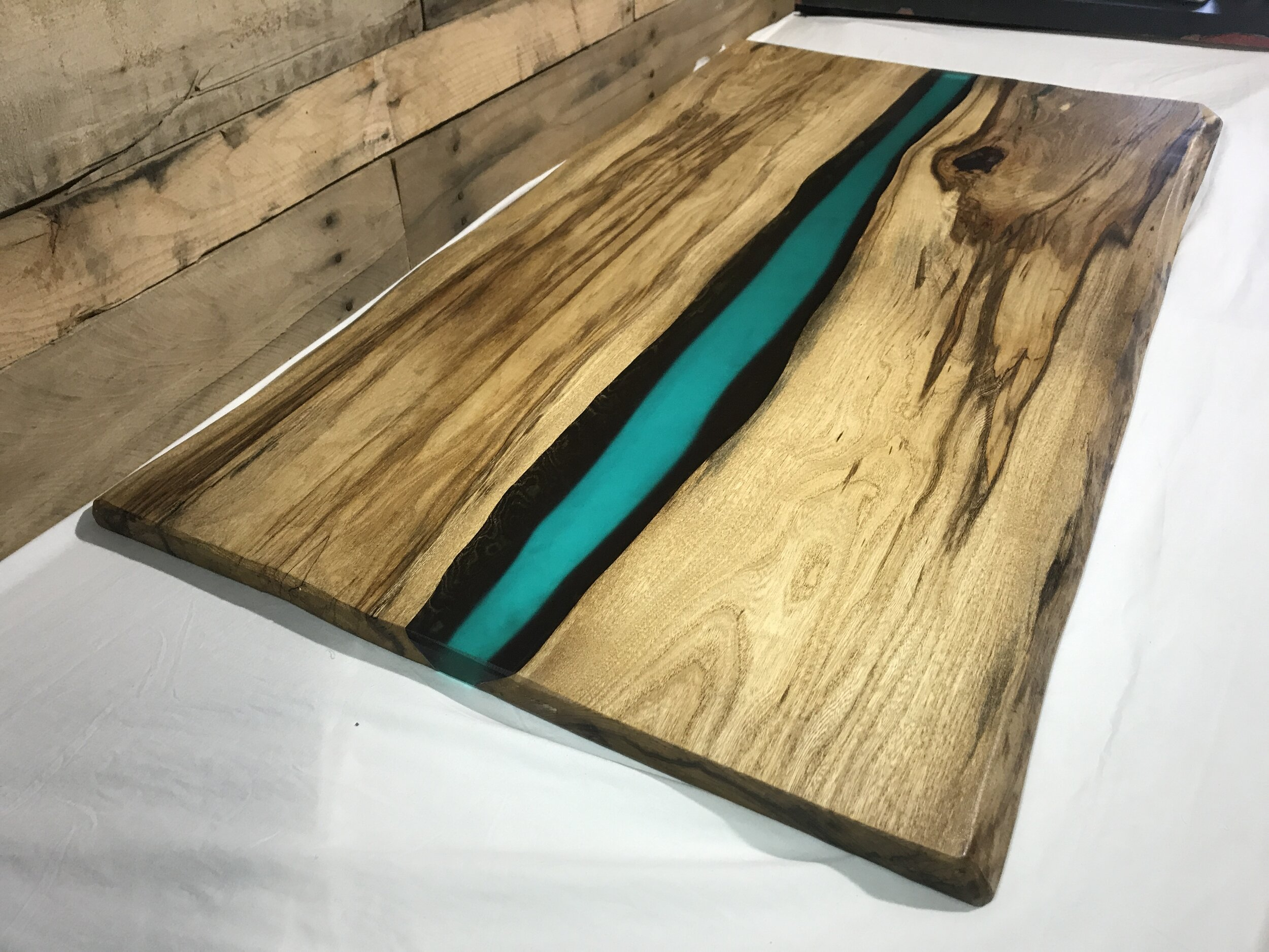 Picture of: Coffee Table Live Edge Hackberry Slab Blue Green Epoxy Resin River Table Omni Artis