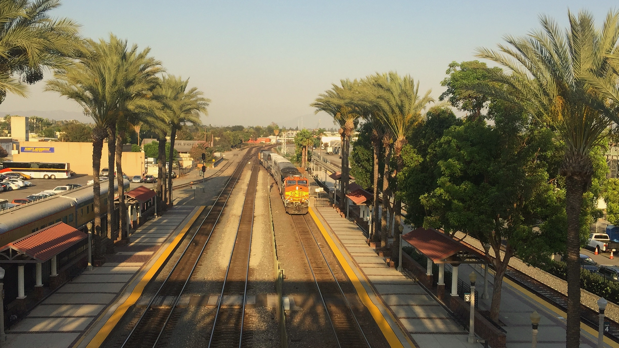 A 91 Line Metrolink train departs from Fullerton, CA, with a leased BNSF AC44 on the rear. Photo by Sergio Magallon, 2016.
