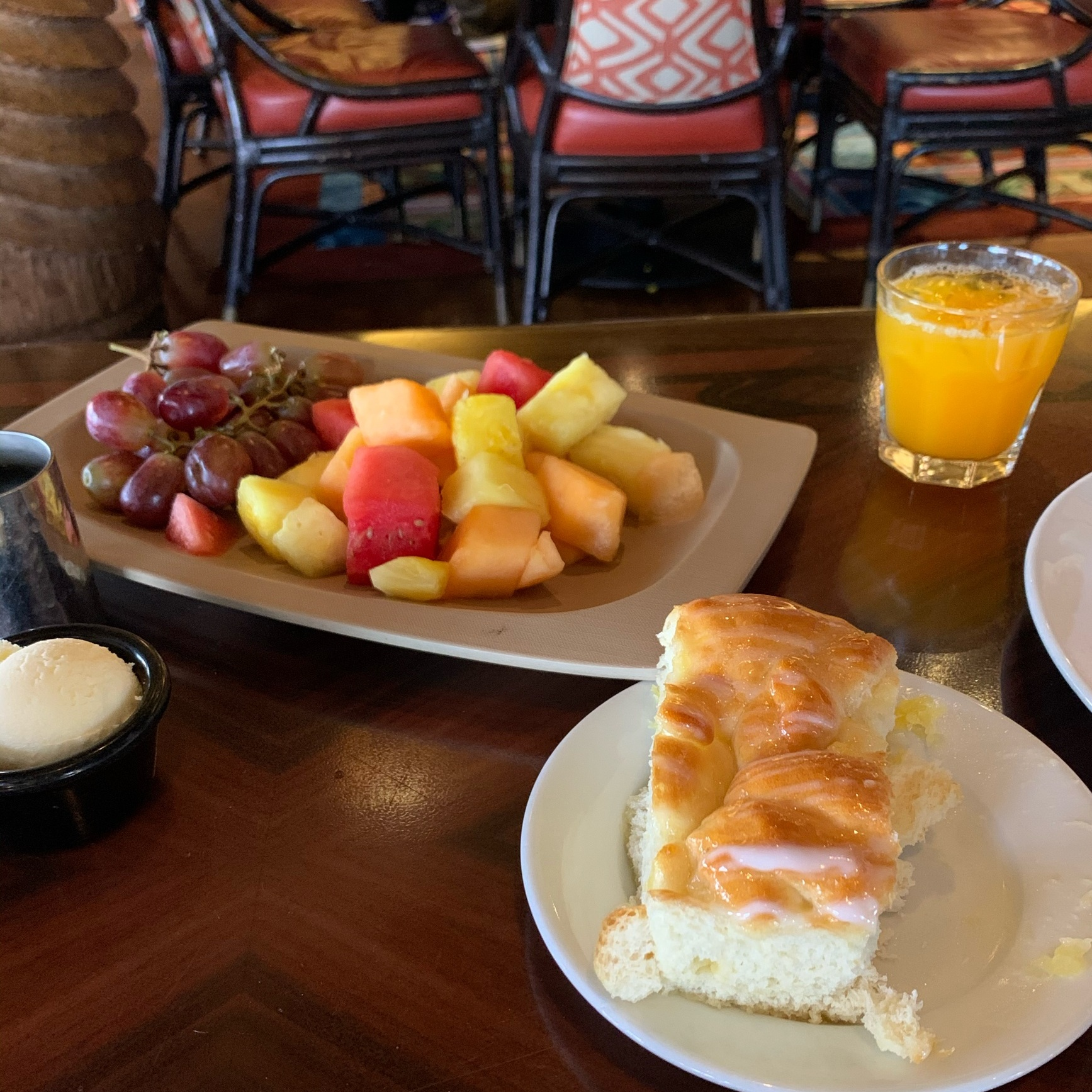 Fruit Plate, Welcome Bread, and Passion Fruit-Orange-Guava (POG) Juice (Dining Review: 'Ohana Best Friends Breakfast Featuring Lilo & Stitch)
