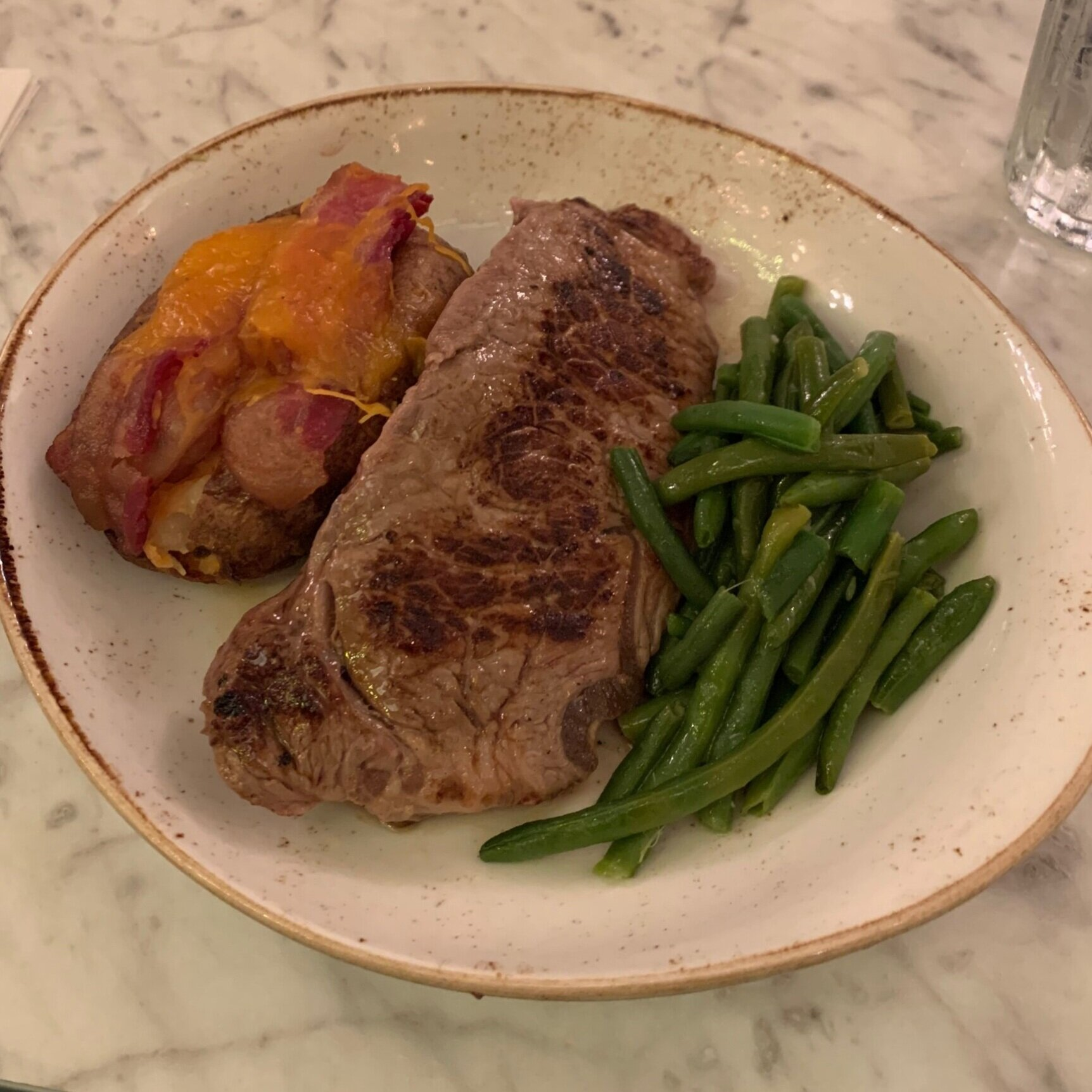 Strip Steak with Green Beans and Twice-Baked Potato at The Plaza Restaurant