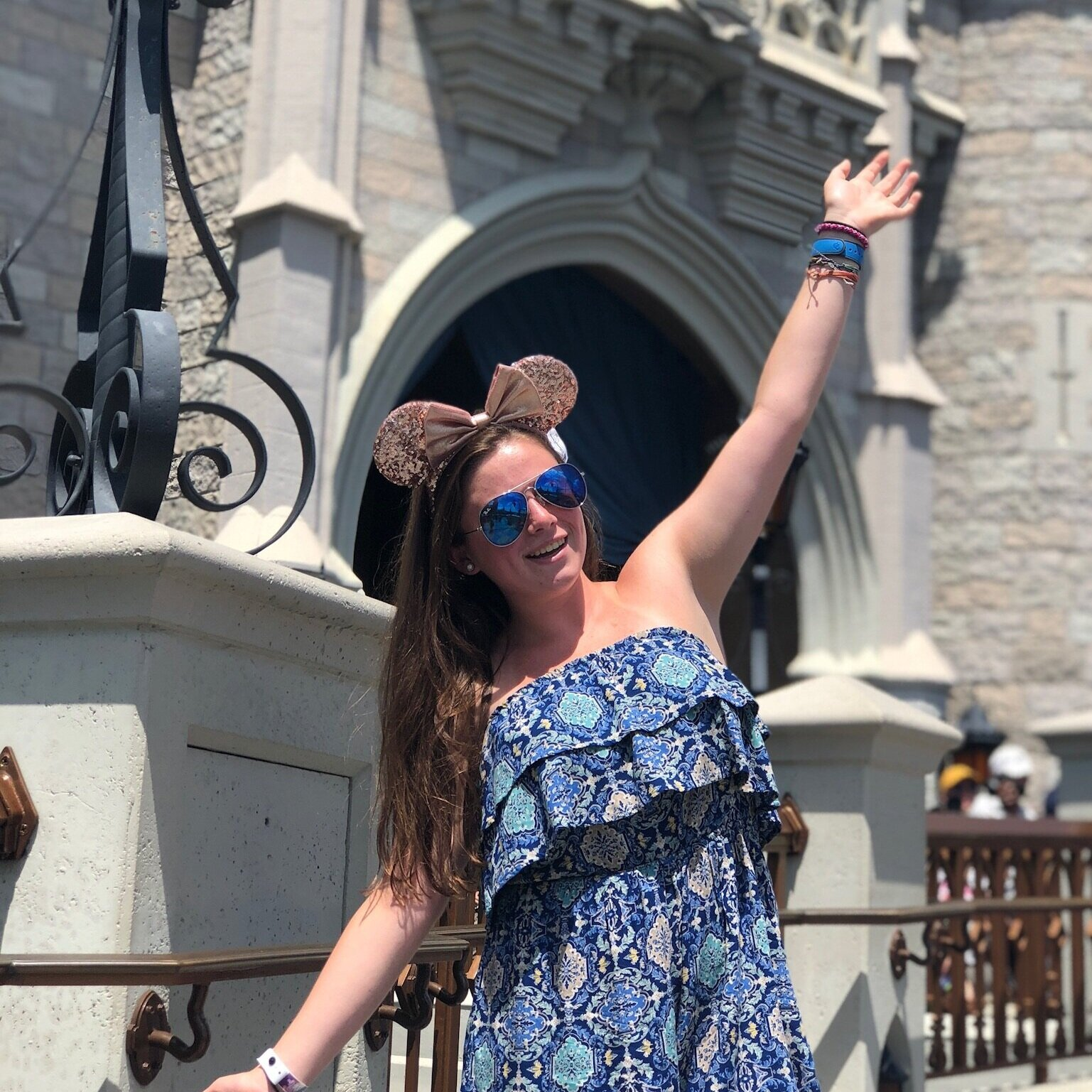 Kira is the center of attention in this Castle pic! - Tips for Taking the Best Photos at Walt Disney World