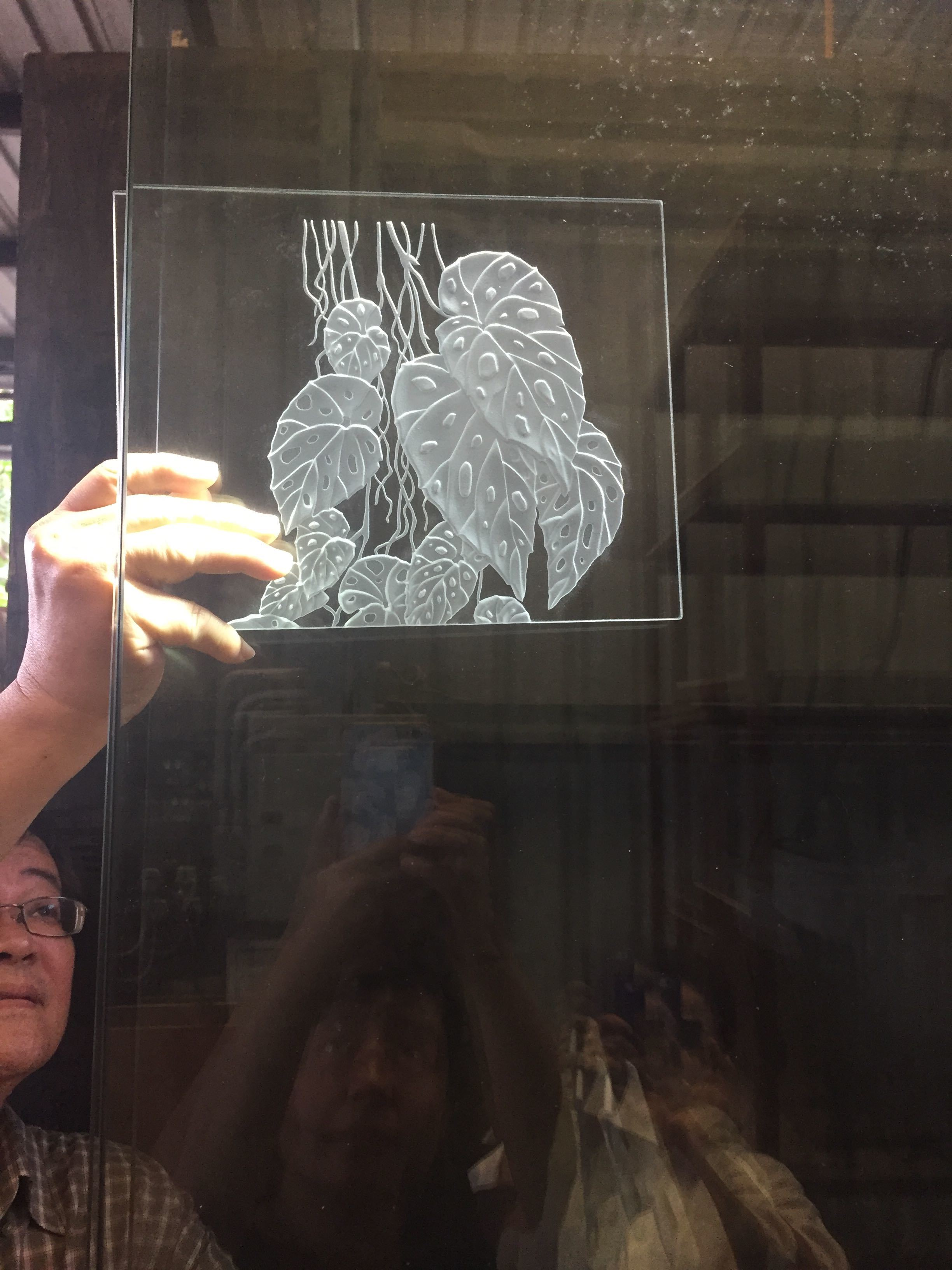Testing a sample piece of etched glass with our intended lighting