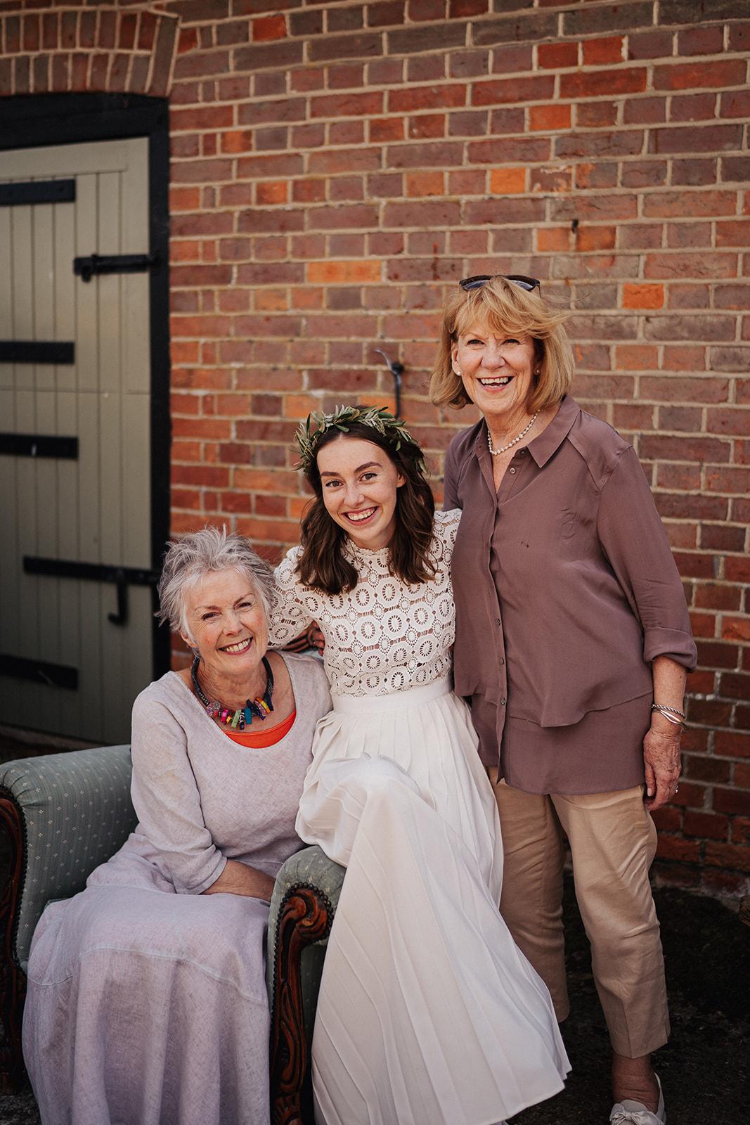 Bride Grace Mandeville with grandparents in self portrait wedding dress