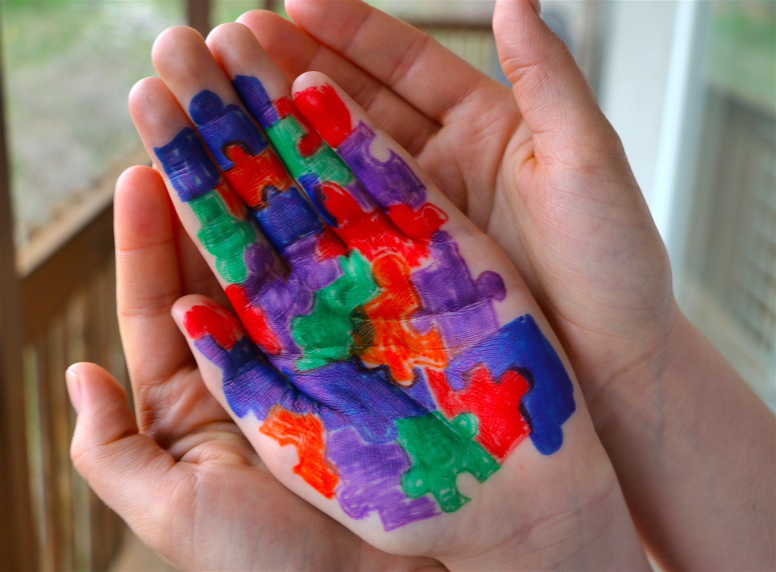 image-of-childs-hand-painted-for-autism-awareness-cupped-in-a-mothers-hands_t20_e8lNXo.jpg