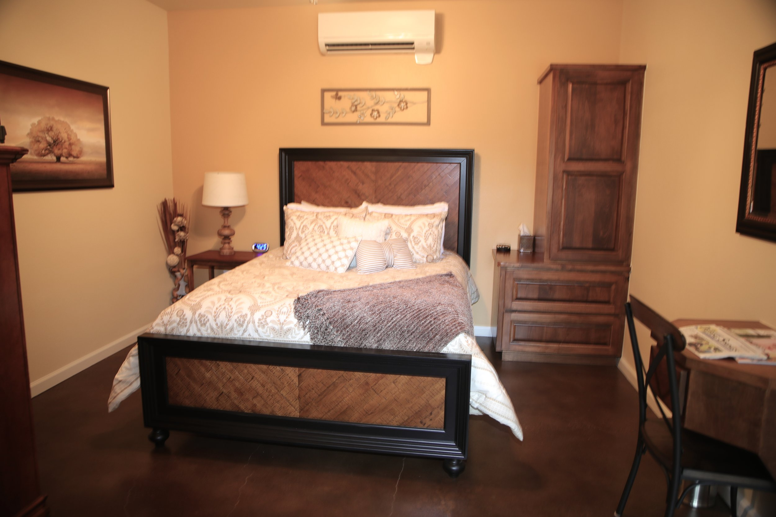 """The Salir Room - """"Salir"""" means to get out in Spanish. This room can accommodate 2 guests.The Salir Room includes a plush queen bed with touches of suede browns and creams, private walk-in bathroom with glass shower, mini refrigerator, cable & internet.Pricing Starting At $175 a night"""