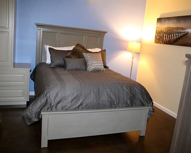 """The Descansar Room - """"Descansar"""" means to rest in Spanish. This room can accommodate 2 guests.The Descansar Room includes a plush queen bed with touches of dark grey and blue, private walk-in bathroom with glass shower, mini refrigerator, cable & internet.Pricing Starting At $175 a night"""