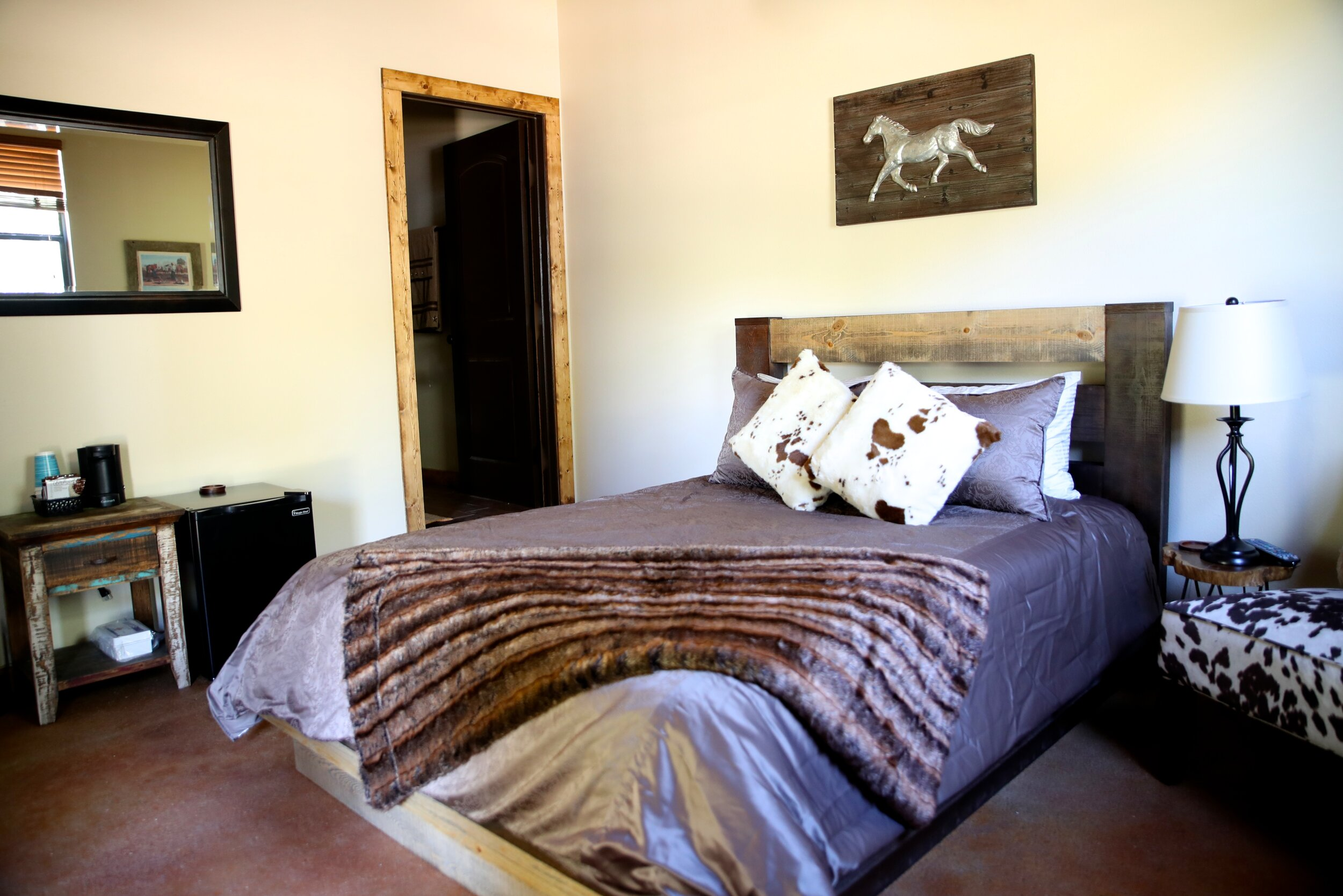 "The Gaucho Room - ""Guacho"" means a cowboy from Southern America pampas. This room can accommodate 2 guests.The Guacho Room includes a plush queen bed with comfortable fuax cowhide chair, private walk-in bathroom with glass shower, mini refrigerator, cable & internet.Pricing Starting At $ 170 a night"
