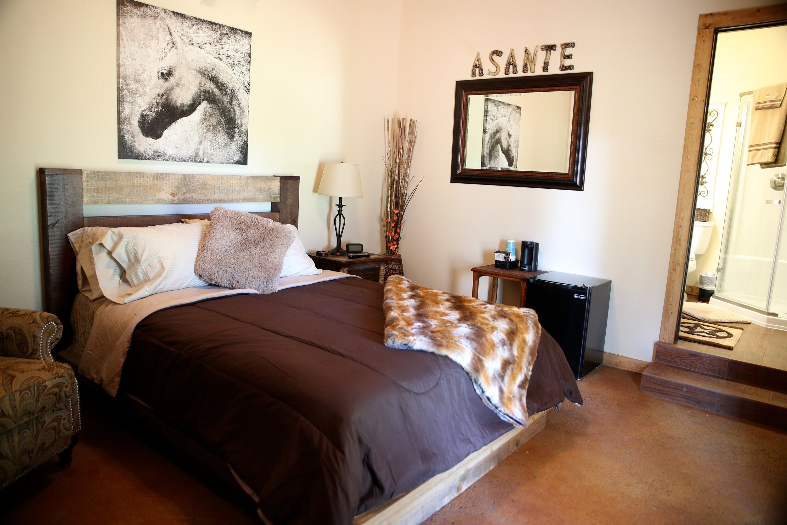 "The Vaquero Room - ""Vaquero"" means a cowboy or cattle driver in Spanish. This room can accommodate 2 guests.The Vaquero Room includes a plush queen bed with touches of equine decor, private walk in bathroom with glass shower, mini refrigerator, cable & internet.Pricing Starting At $ 170 a night"