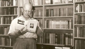 Plum in his library at his Long Island home, with many of his books behind him -