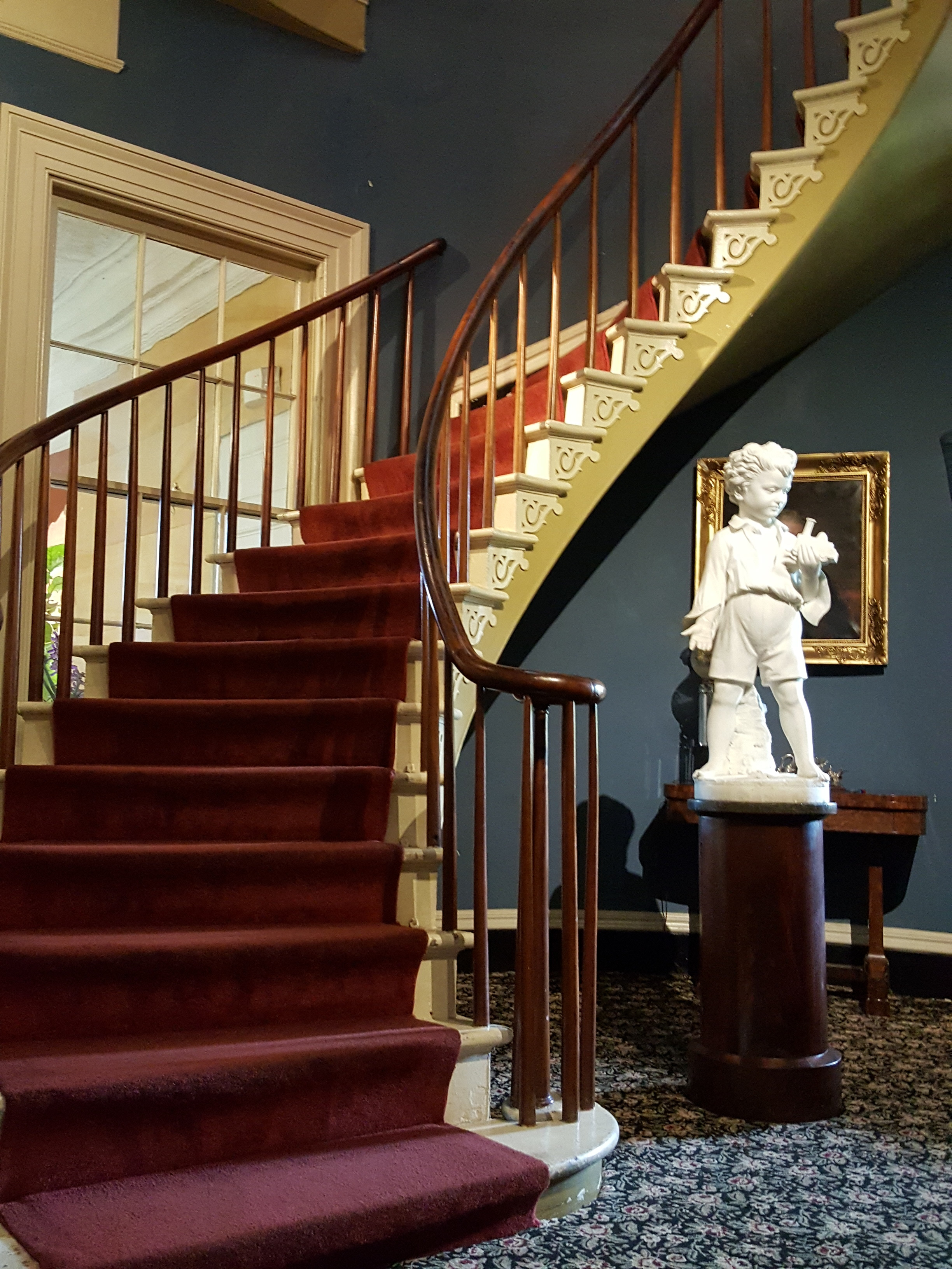 The freestanding staircase where a young girl in a blue dress often makes appearances.