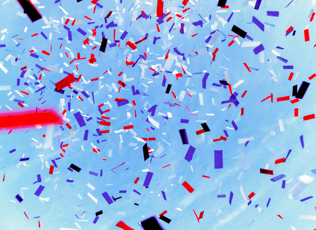 Celebrating a new year with confetti falling from the sky.