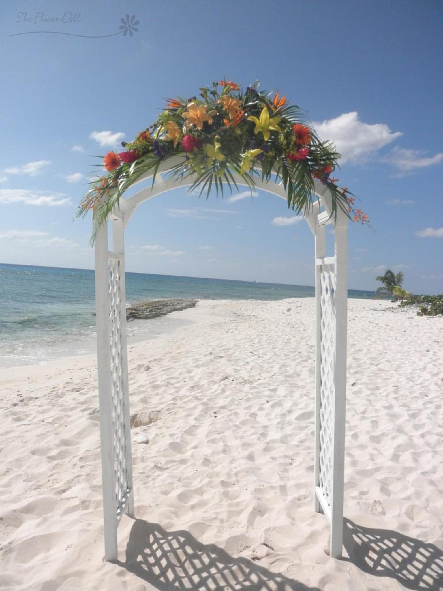 Ceremony-arch-with-tropical-spray.jpg