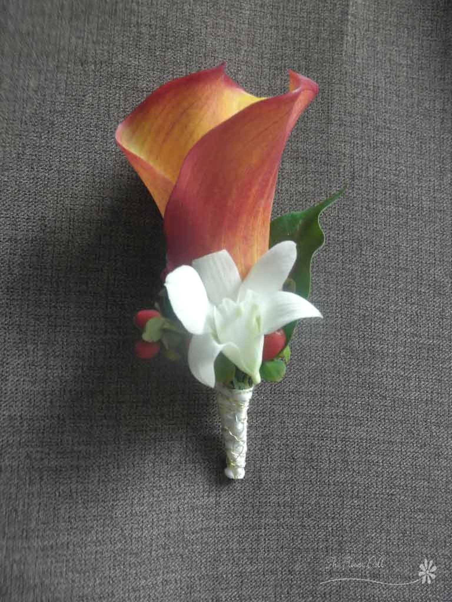 Boutonniere Calla and orchid.jpg