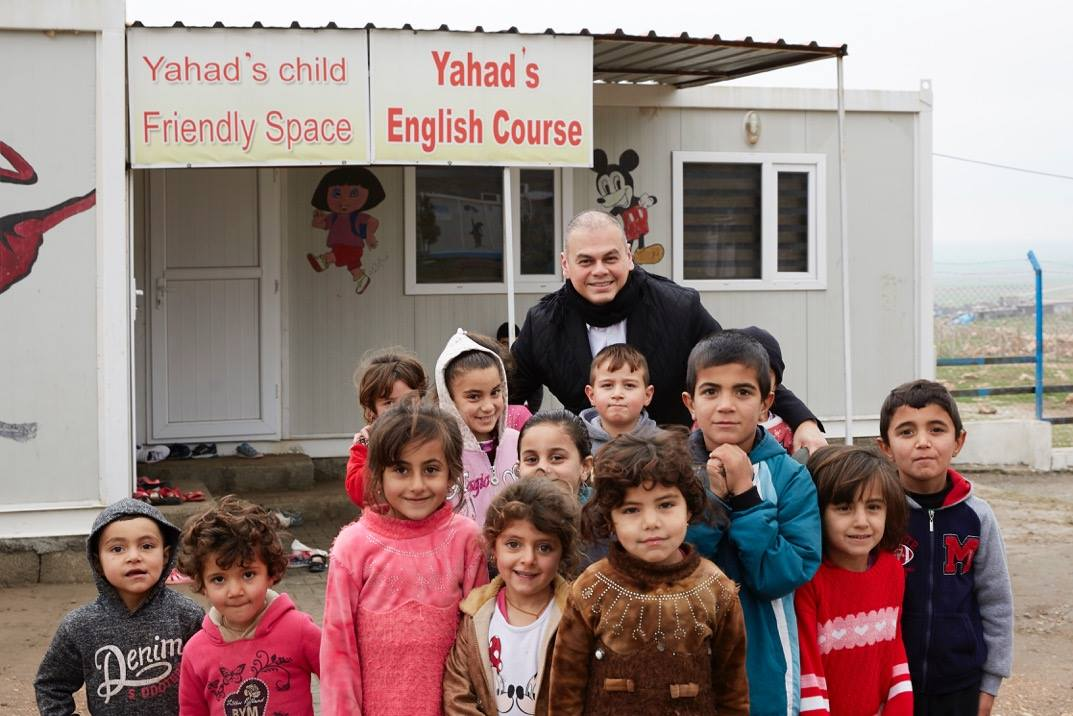 Marco with Yazidi orphans in refugee camp