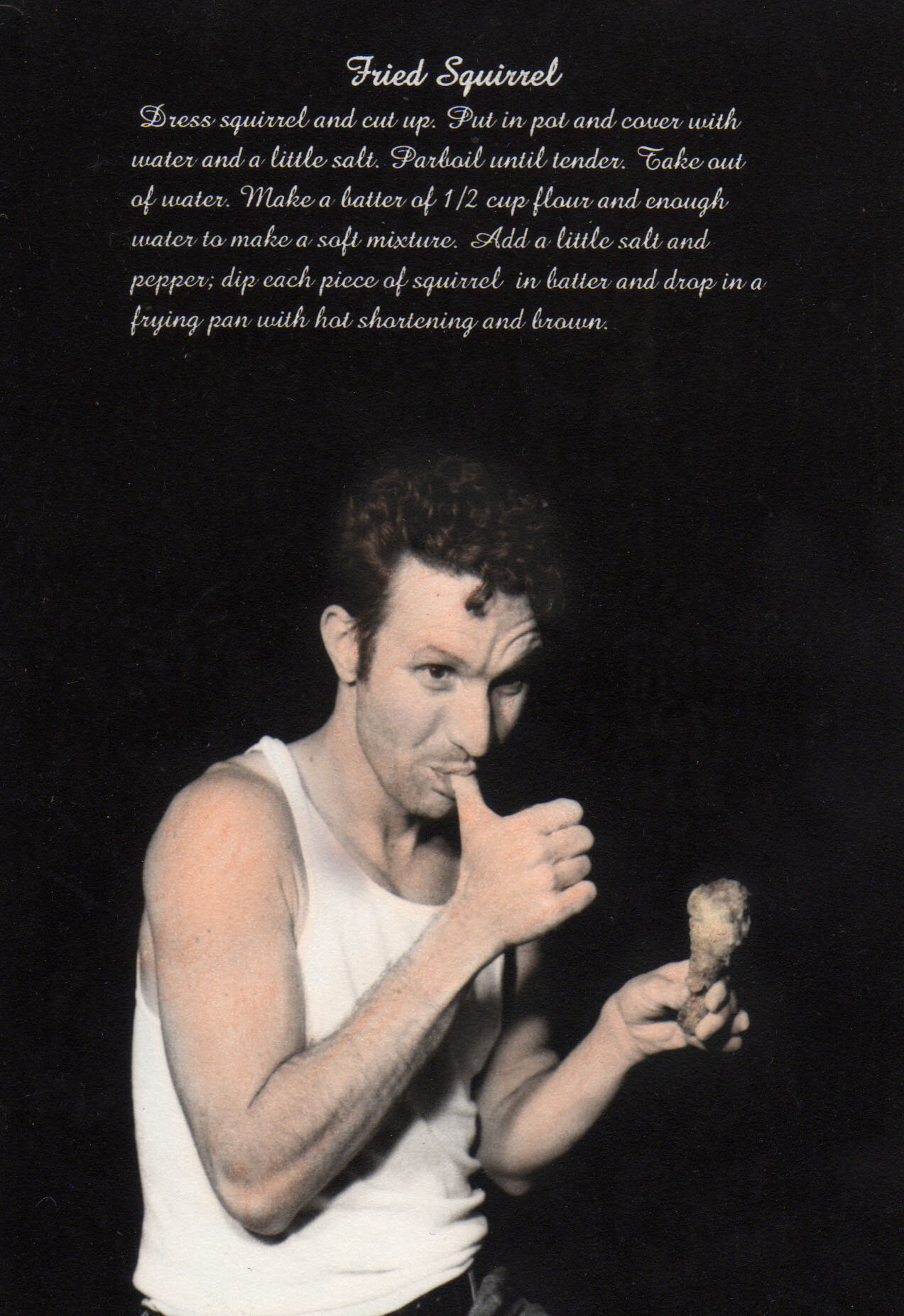 Bobby enjoying some fried squirrel in a hand-colored silver gelatin print from 1999.