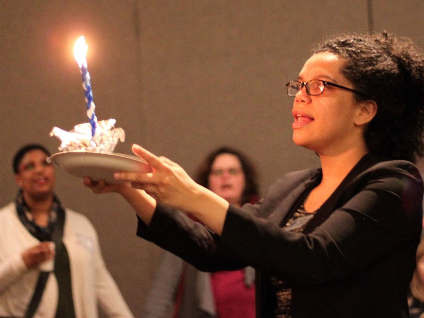 April holding havdallah candle, saying blessing