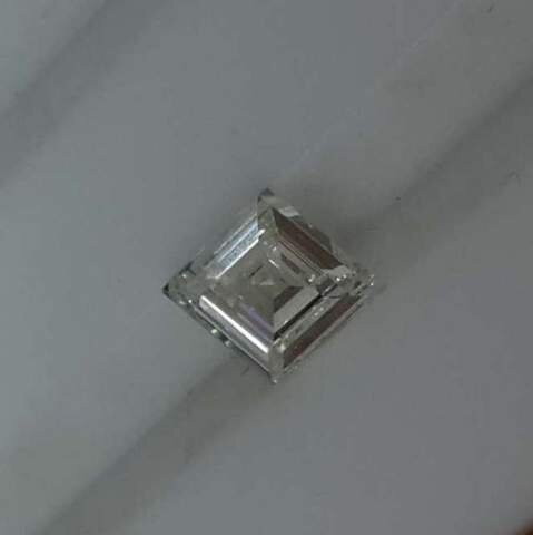 Does this lozenge shaped diamond look like the stuff of your bridal dreams? Secrète Fine Jewelry can help design the perfect ring around any shape of stone-- since we make all our own jewelry in centuries-old traditional methods, you're not confined to what will fit into pre-fab settings. We make each ring by hand to your specifications.