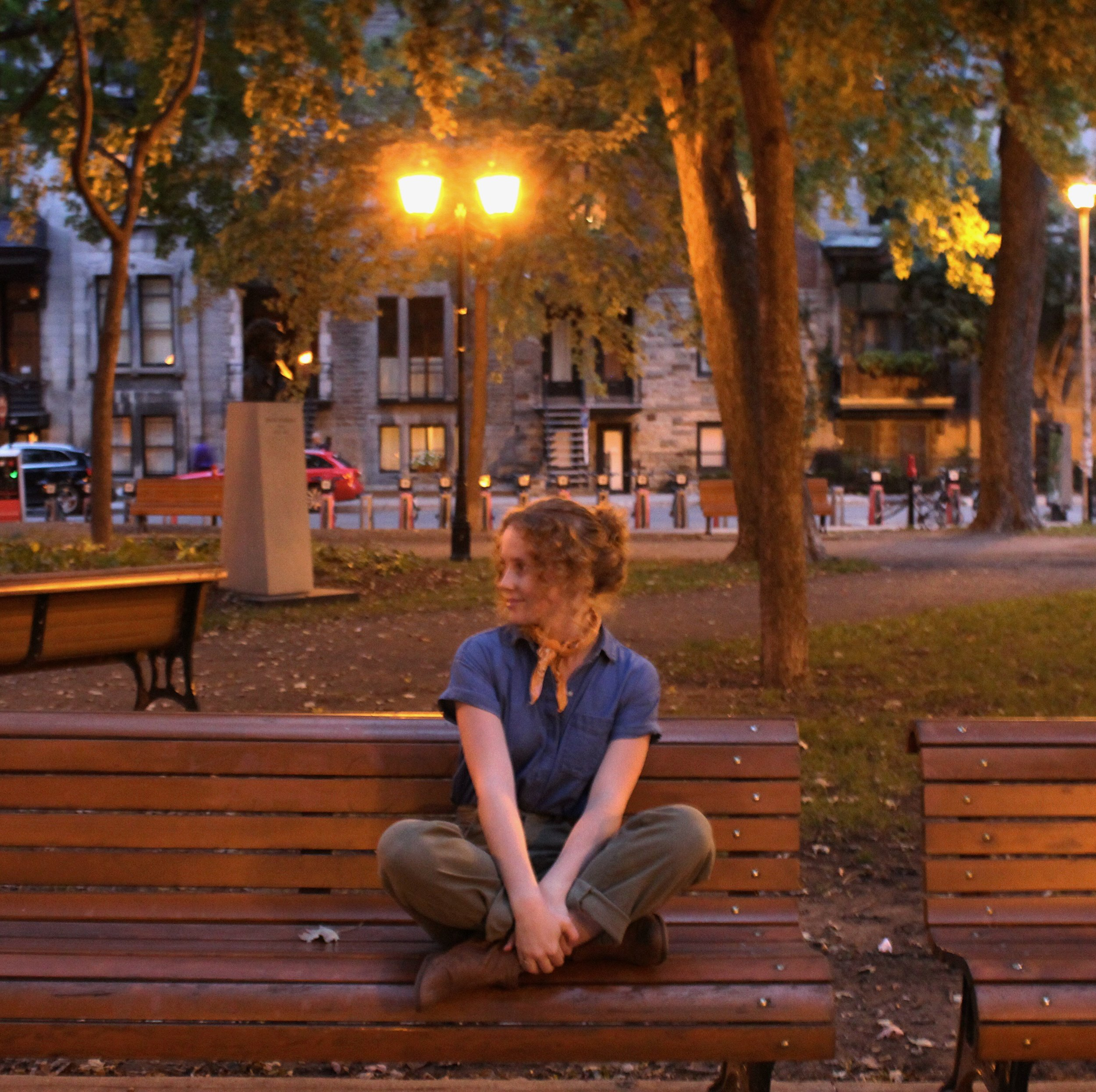 girl sitting on bench in park