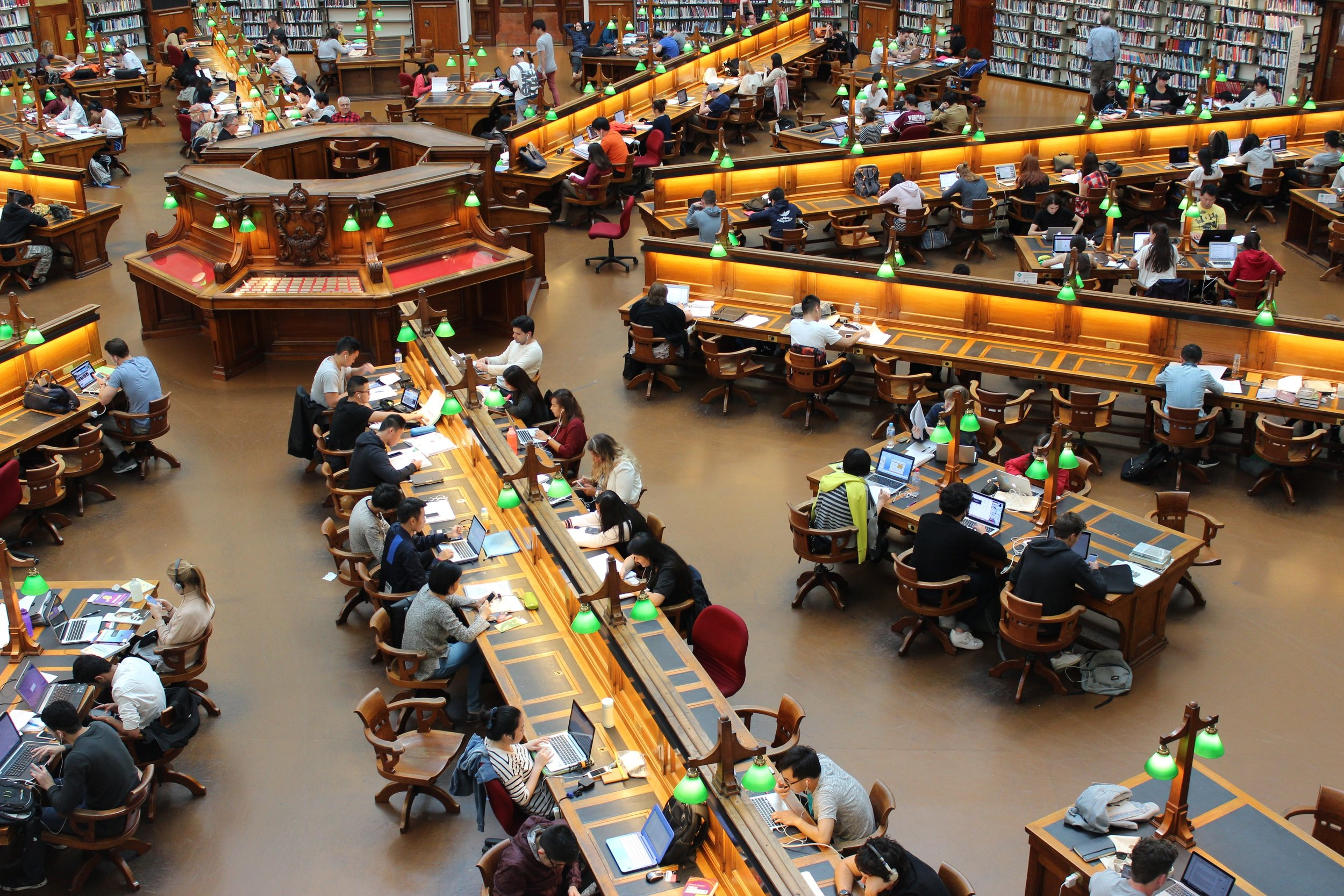 overhead picture of people studying in a library