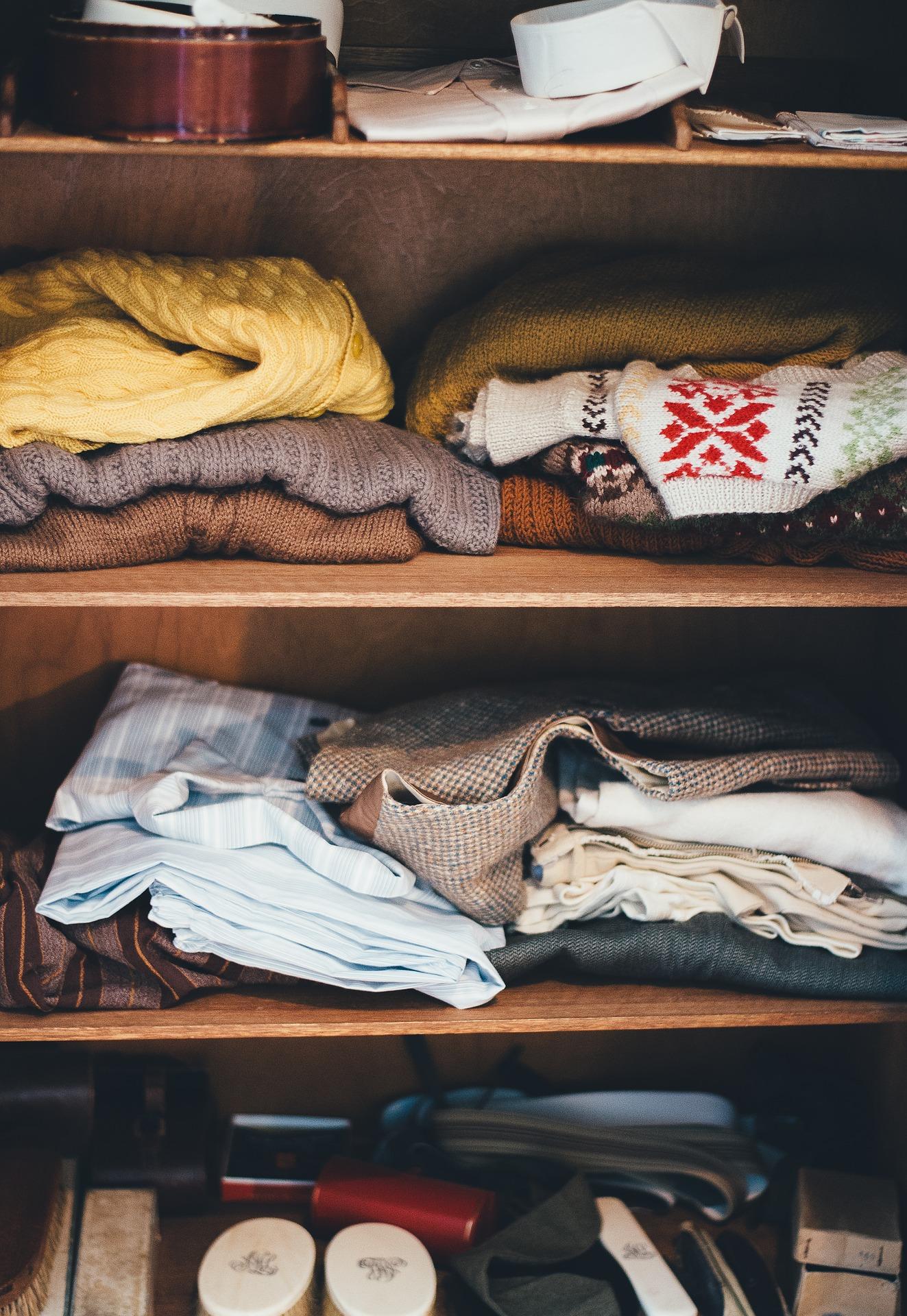 clothes folded on shelf