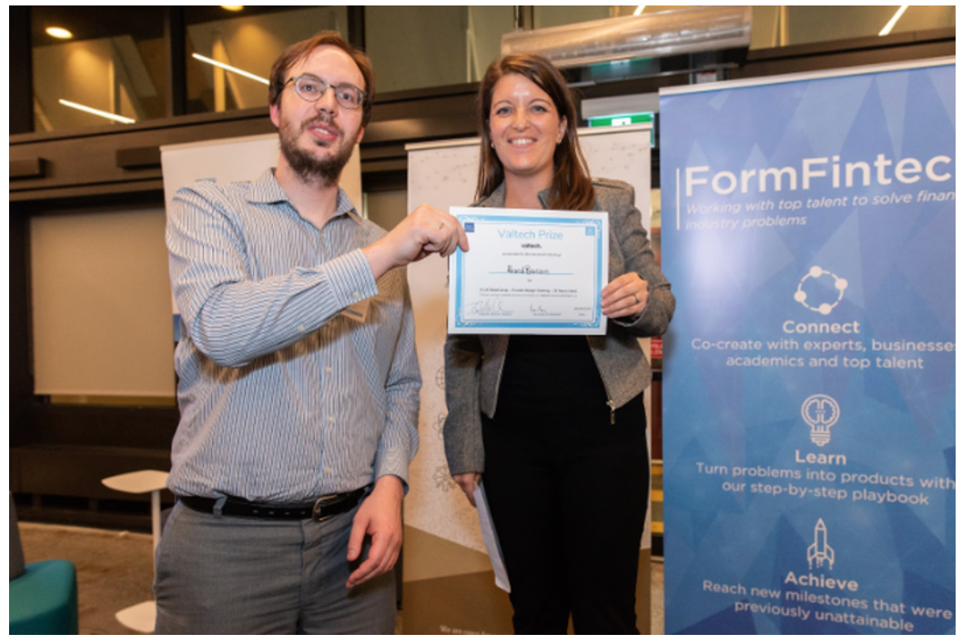 Julien Brault receiving the UX/UI award from Valtech's Isabelle Charron (Director, Client Services)