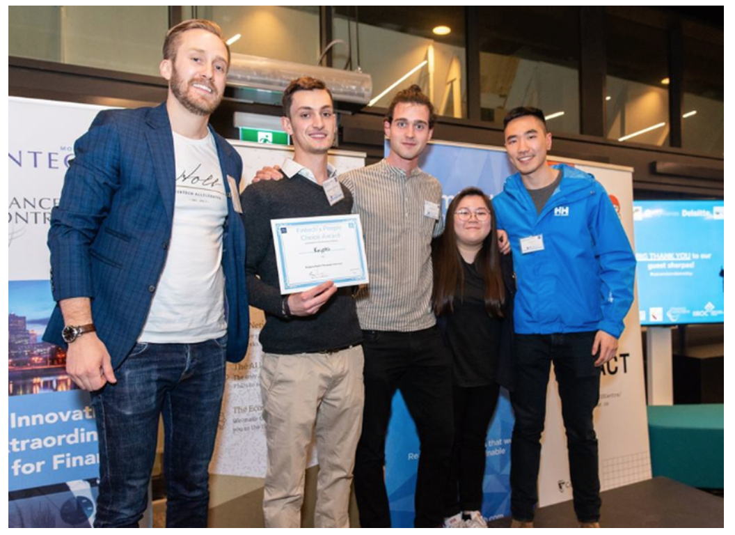 Jan Arp, Managing Partner at the Holt Accelerator (left) presenting his award to co-founders of Krypto, Alexandre Roubaud (2nd from left), Gauthier Gidel (3rd from left), Tommy Luo (extreme right), and Loreina Chew (2nd from right).