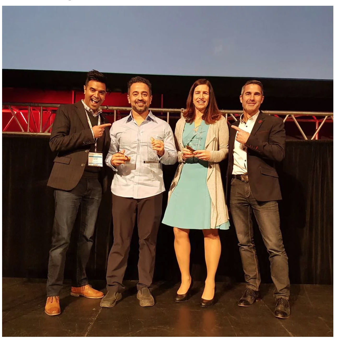 Symend's Hanif Joshaghani and Lendified's (now called Judi.ai) Monique Morden receiving prizes from Luge Capital partners, David Nault (extreme right) and Karim Gillani (extreme left)