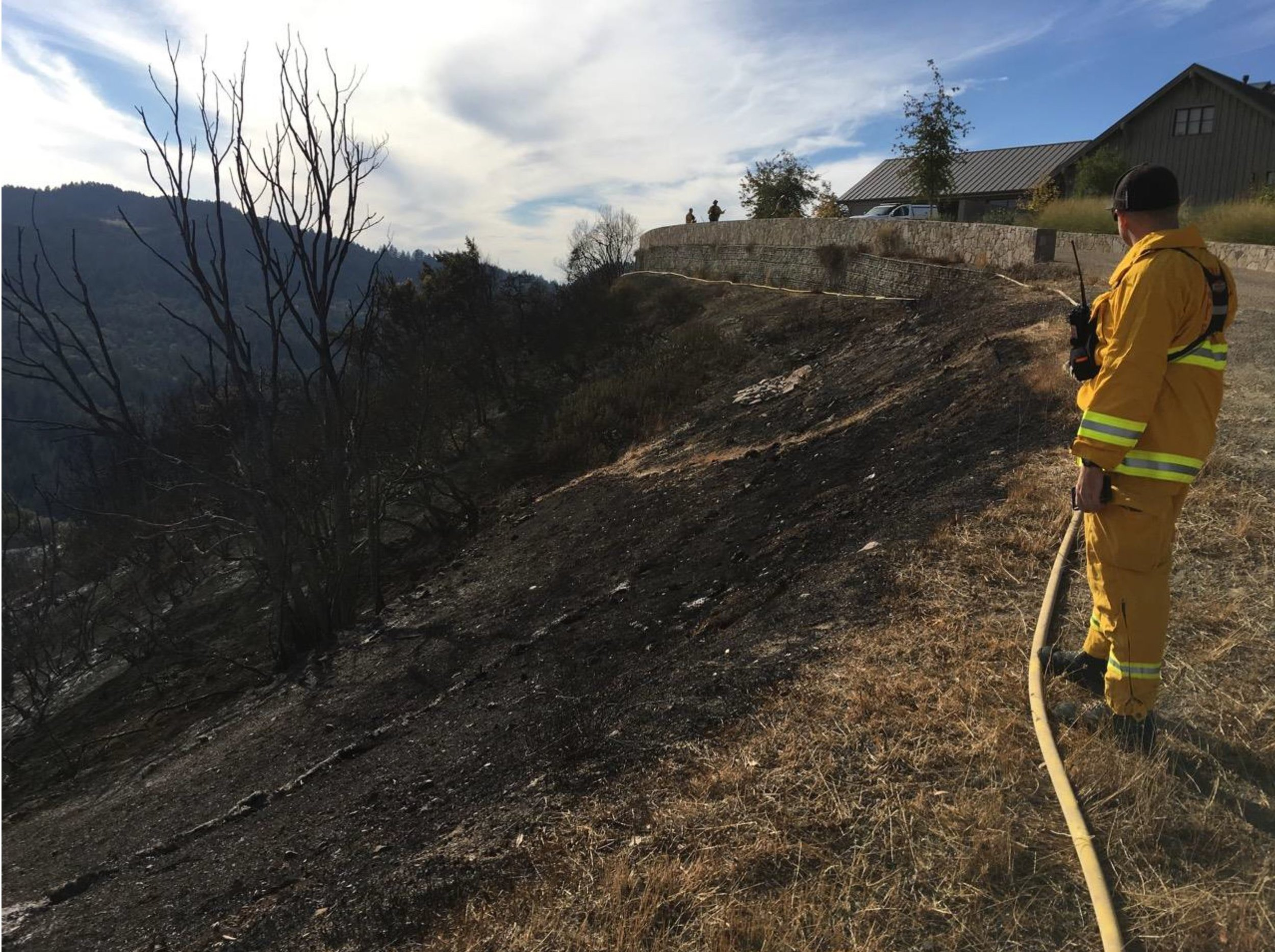 The October 2017 Clear Water Creek Fire near the DCL Fire Station. The wall directed the fire upward away from the house.