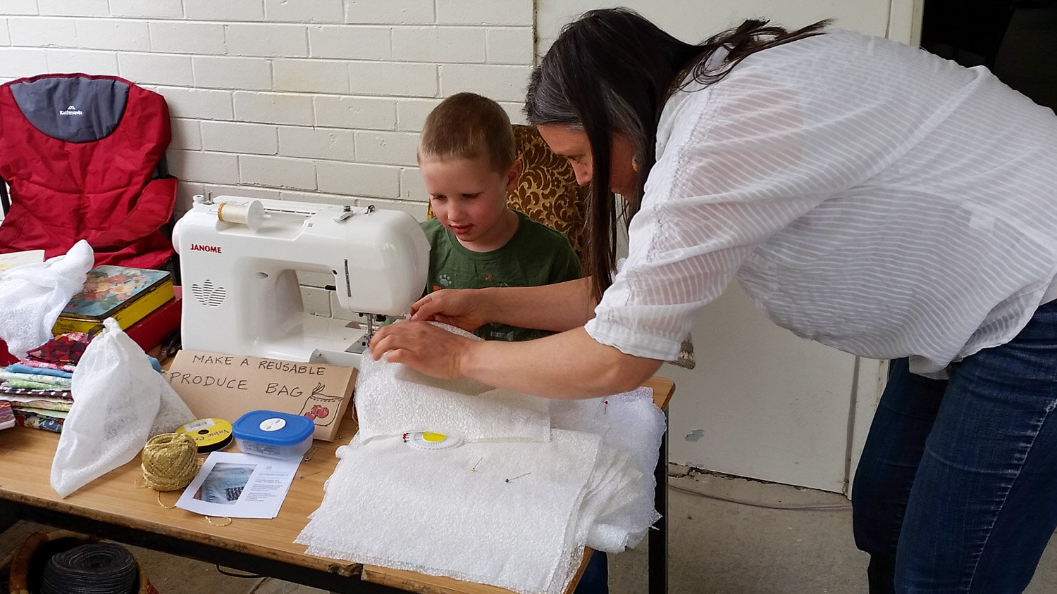 young boy sewing.jpg