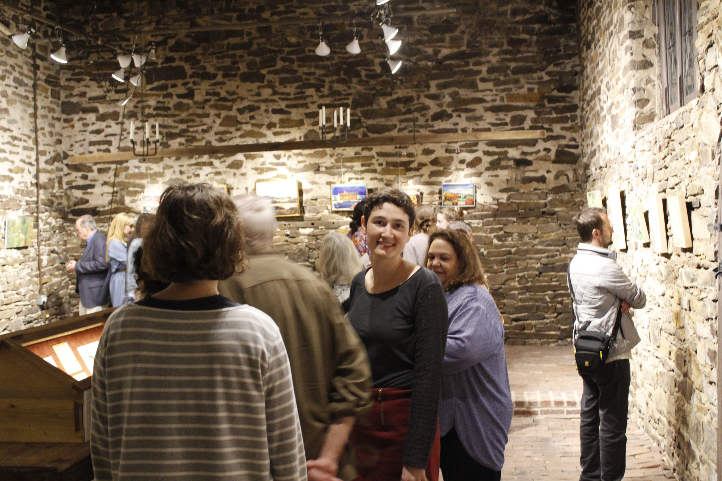 Artist Rotem Amizur and guests in the Chapel Gallery, paintings by Albert Kresch, opening reception 2018.
