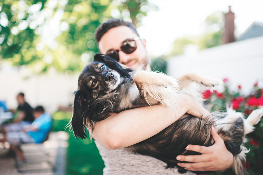 man holding dog in arms