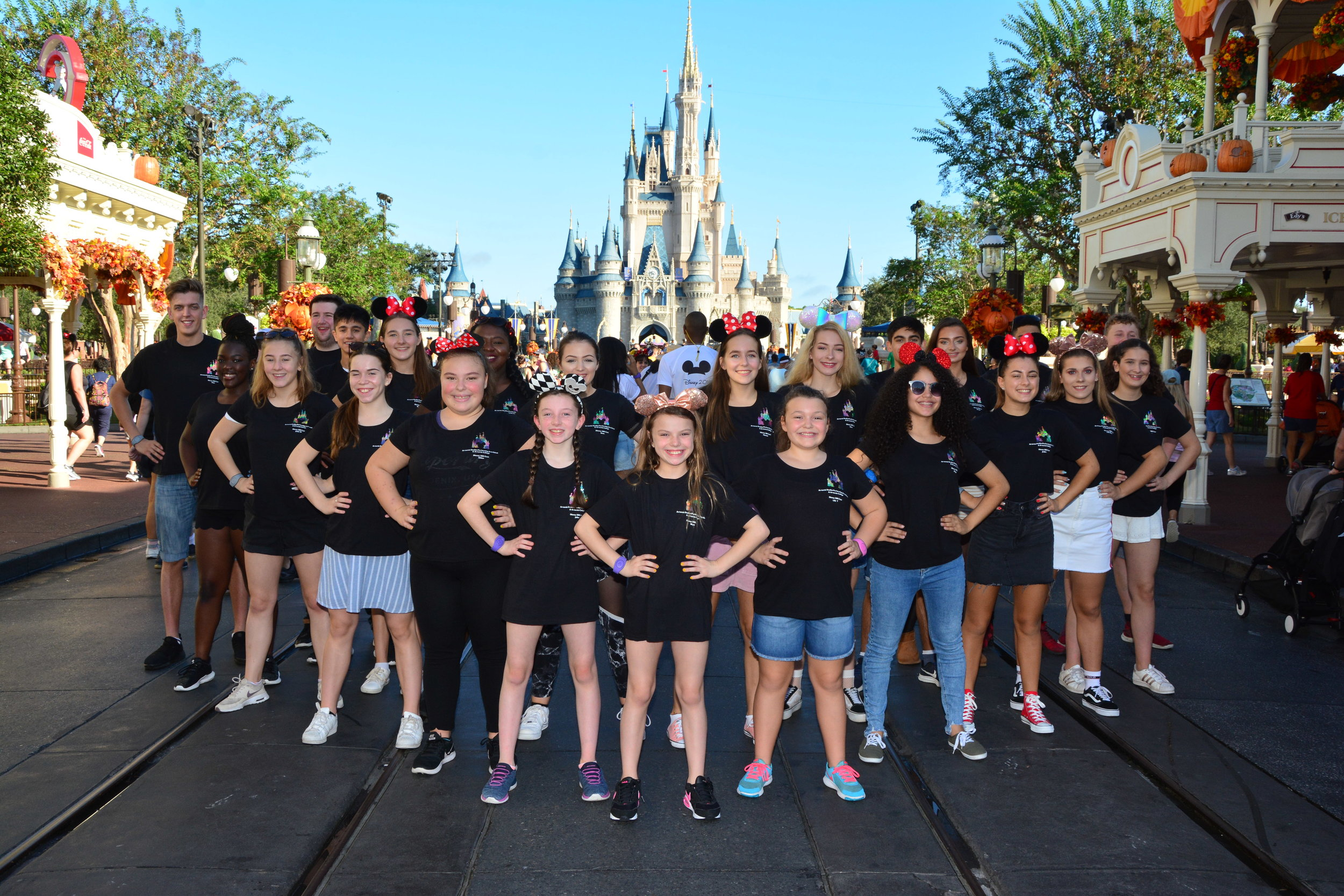 The Artemis Disney 2018 Cast in front of the Magic Castle