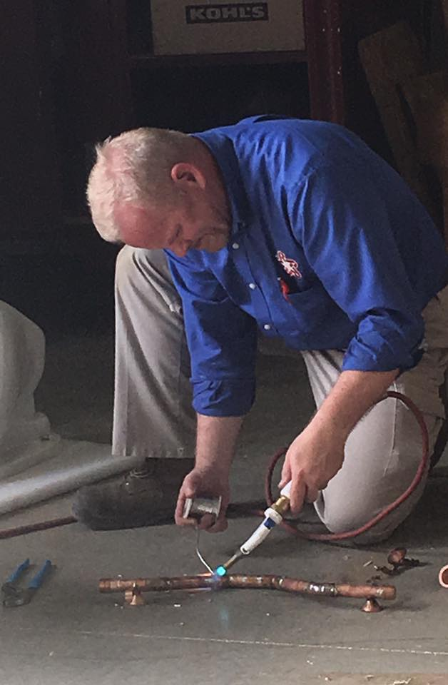 Student Ron Faulkner completing the soldering portion of his plumbing journeyman licensing examination