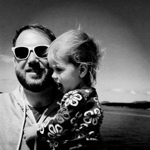 Ryan-with-kiddo-shades-BW-300x300.jpg