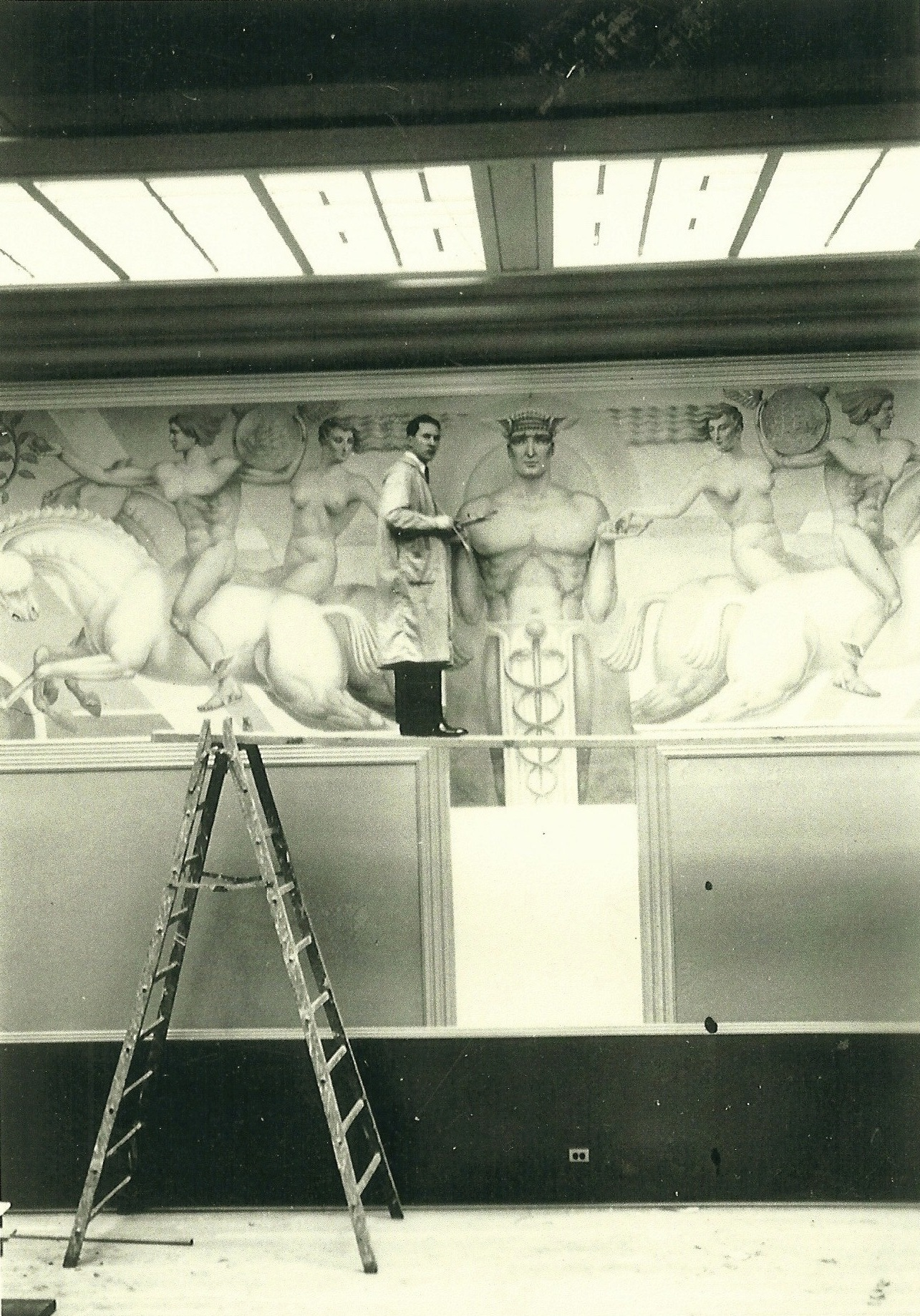Angelo-painting-mural-for-AP-Gianini-Bank-of-America-at-the-exhibition-on-Treasure-Island-CA.jpg