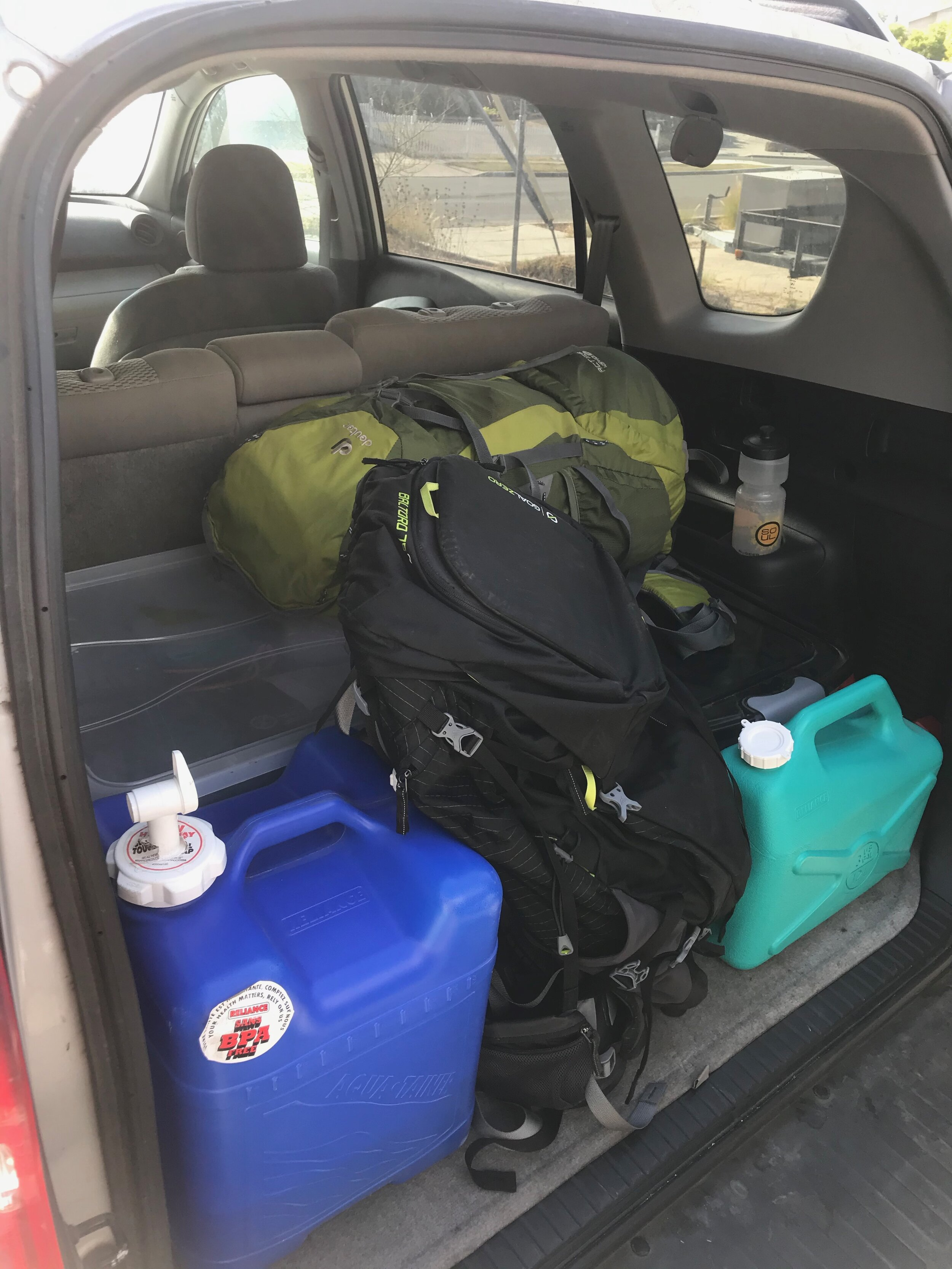 In the trunk we've got both of our 72-hour bags, 7- and 3- gallon water storage containers, the plastic tub of camping gear, and the plastic tub of medical supplies. It takes about 3 minutes to put in the car, and there is plenty of extra room.