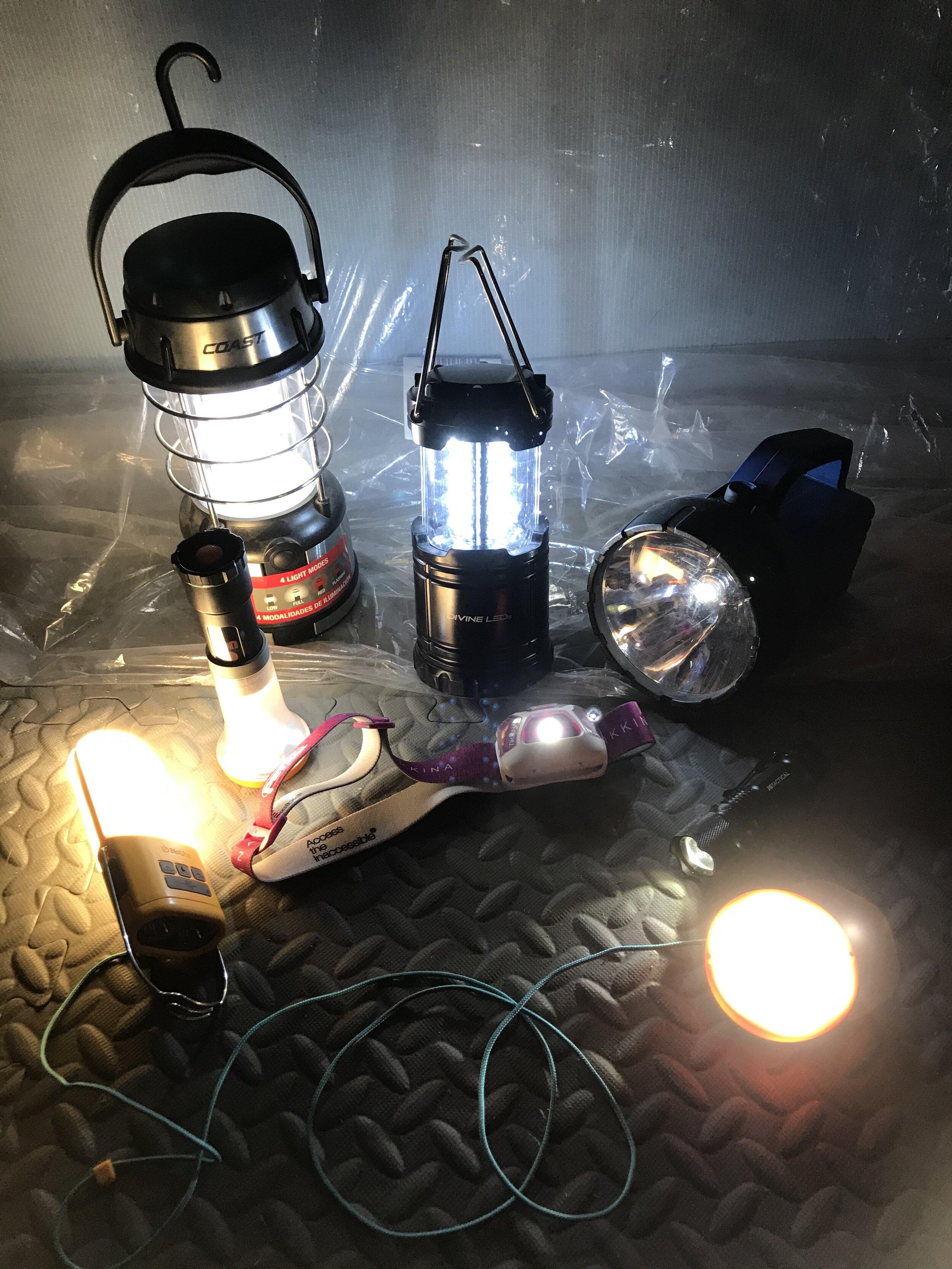 A few of my many, many flashlights, lanterns, and headlamps
