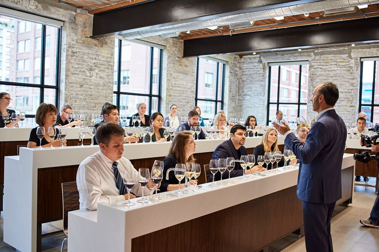 A wine masterclass taking place in the Food & Beverage Theatre at 215 King Street East, Toronto