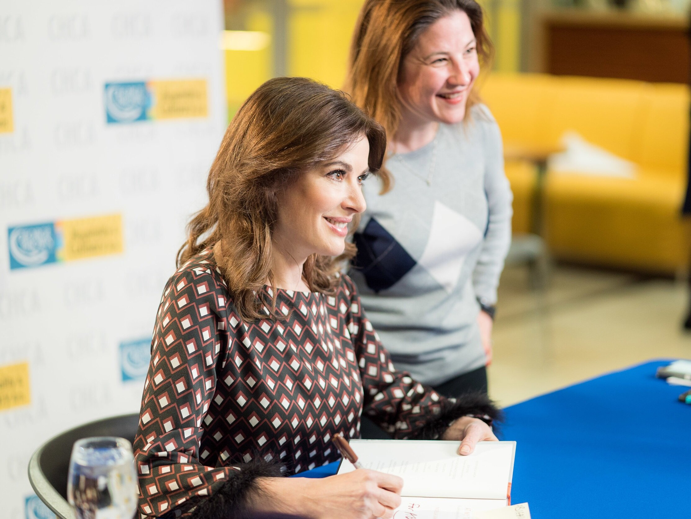 Nigella Lawson signing books with a guest at George Brown College's Centre for Hospitality & Culinary Arts