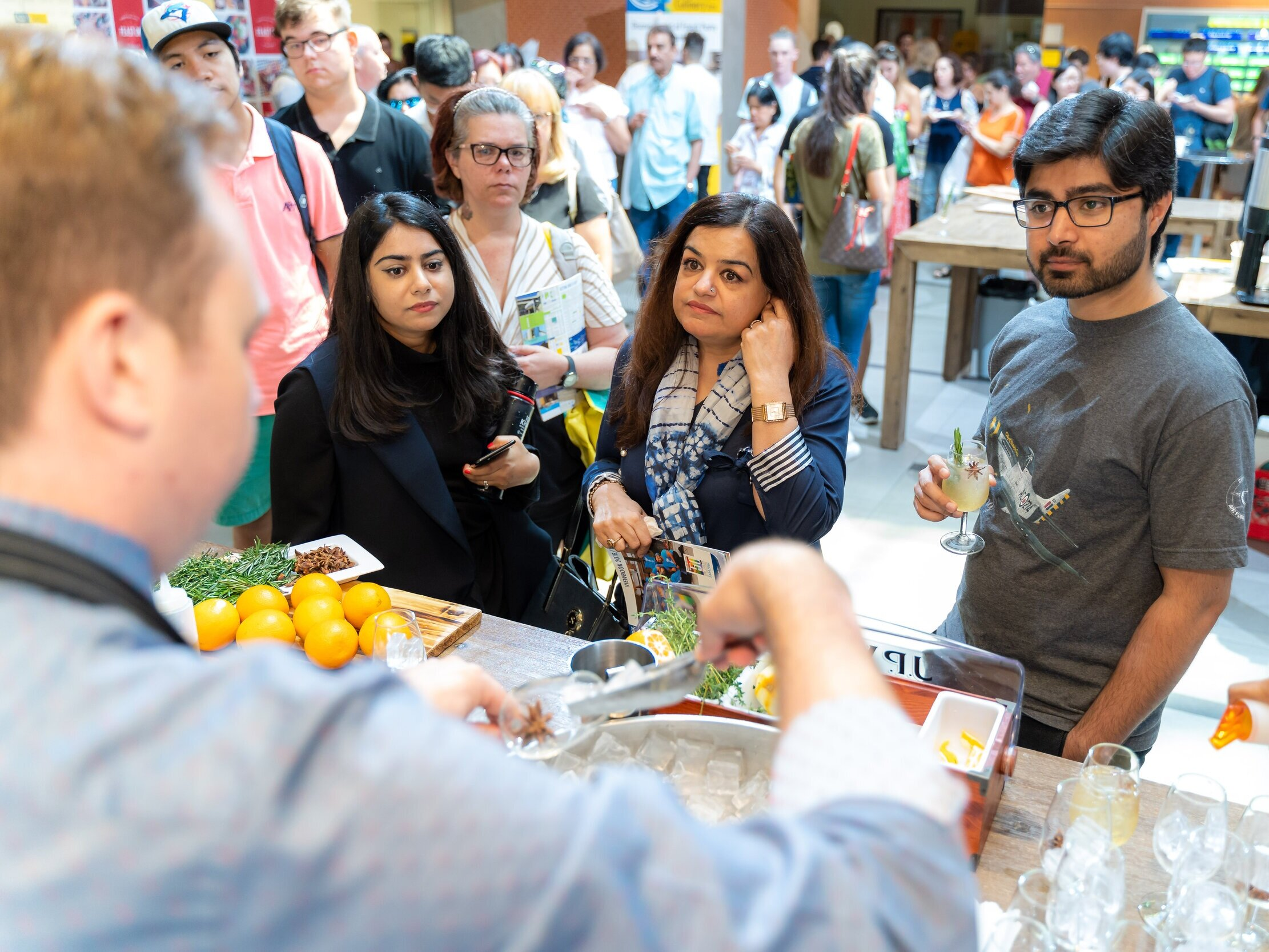 Guests attending a food & drink marketplace festival at George Brown College's Centre for Hospitality & Culinary Arts