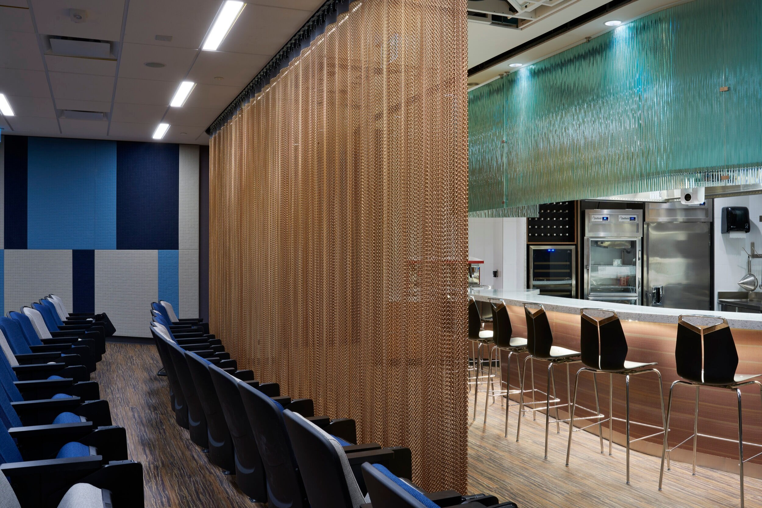 Alternate side view of the chef's table with privacy curtain in the Culinary Demonstration Theatre at the Centre for Hospitality & Culinary Arts at George Brown College