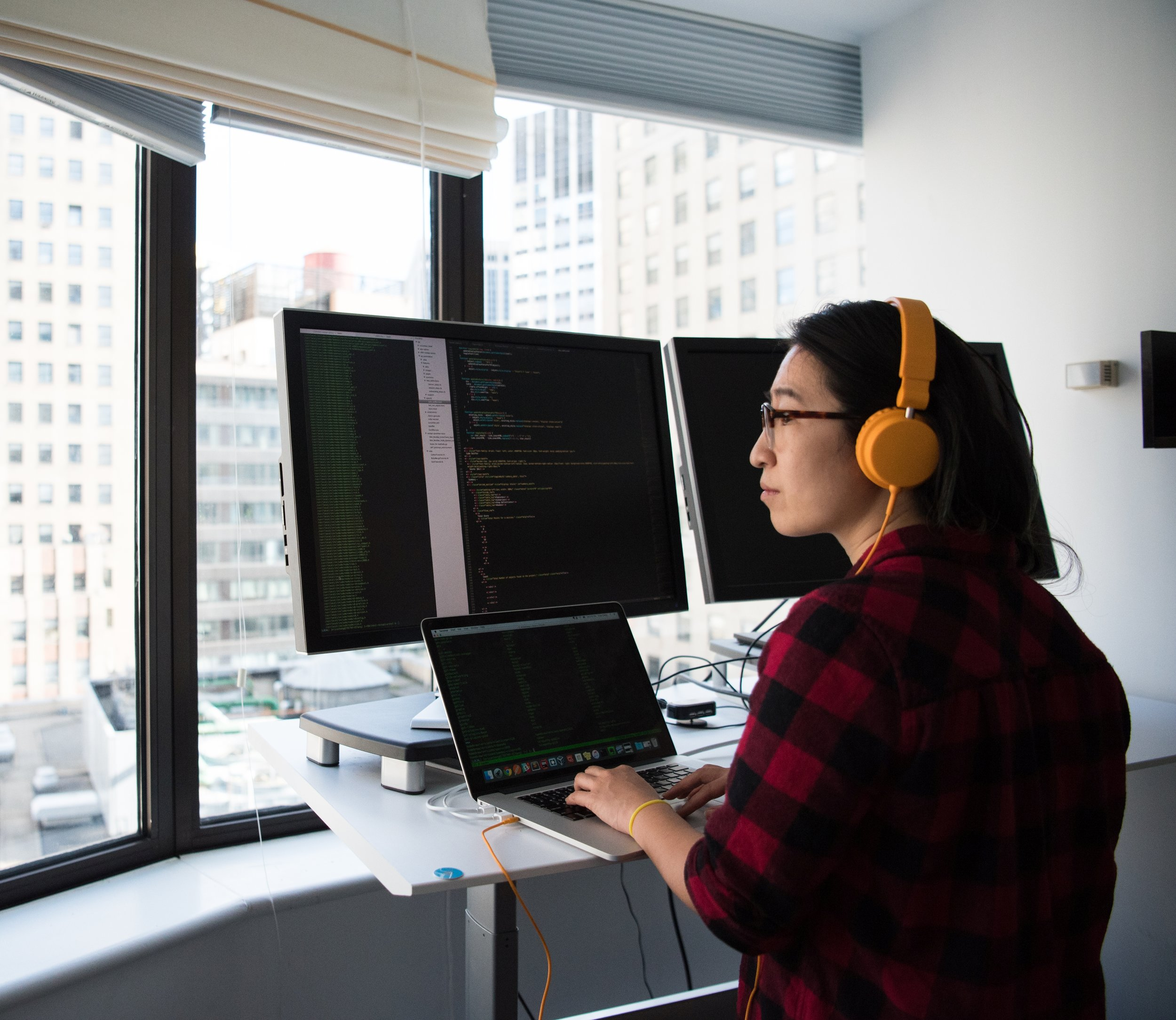 Canva - Woman Sitting While Operating Macbook Pro Crop.jpg