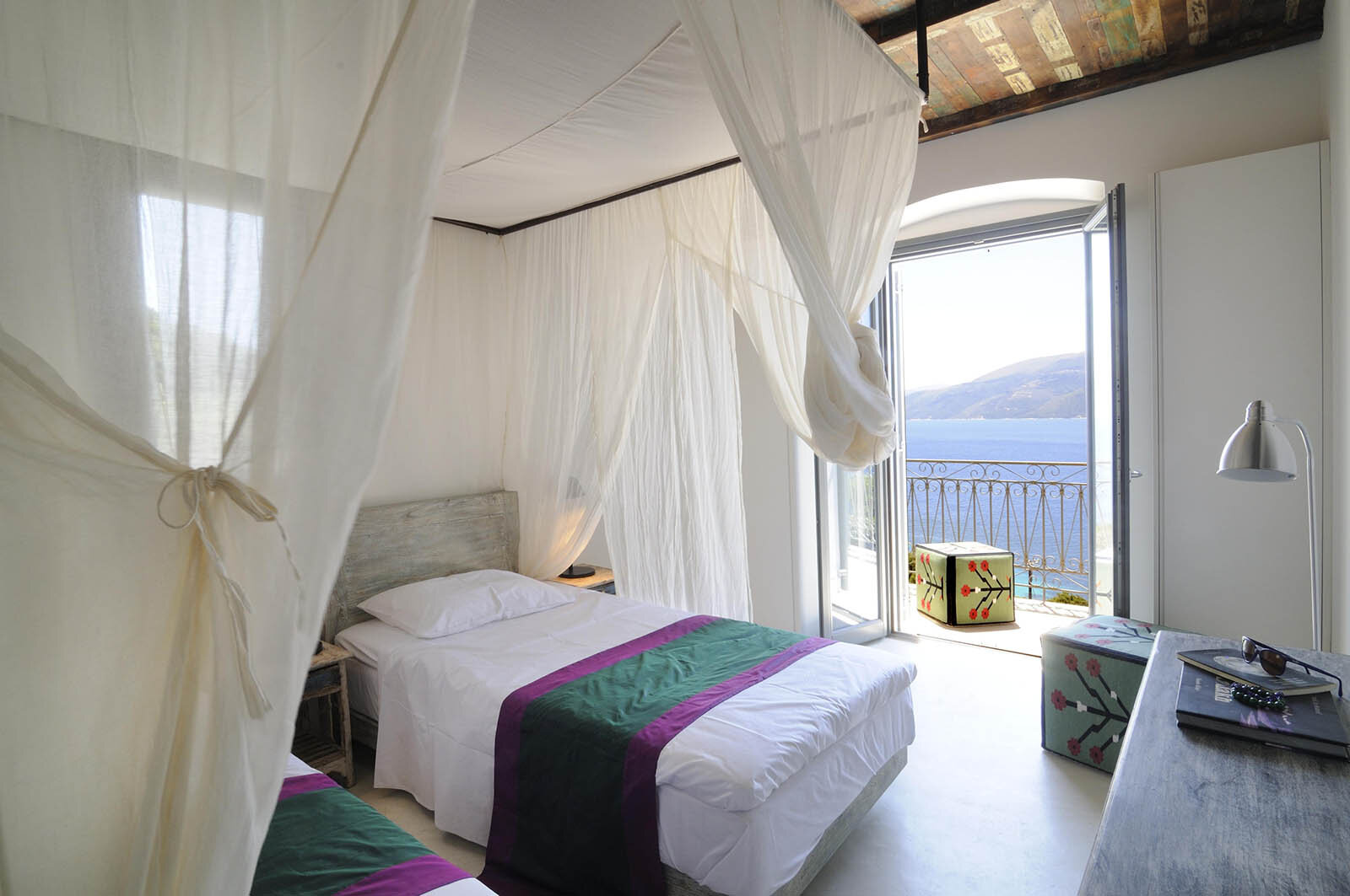 India - Shared - $3250 (per person - you'll be paired with another sister in our group)Large, spacious bedroom with two twin beds at the end of the first floor corridor. Includes ensuite bathroom with bath tub, air conditioning, large private balcony, and views of the Ionian sea.