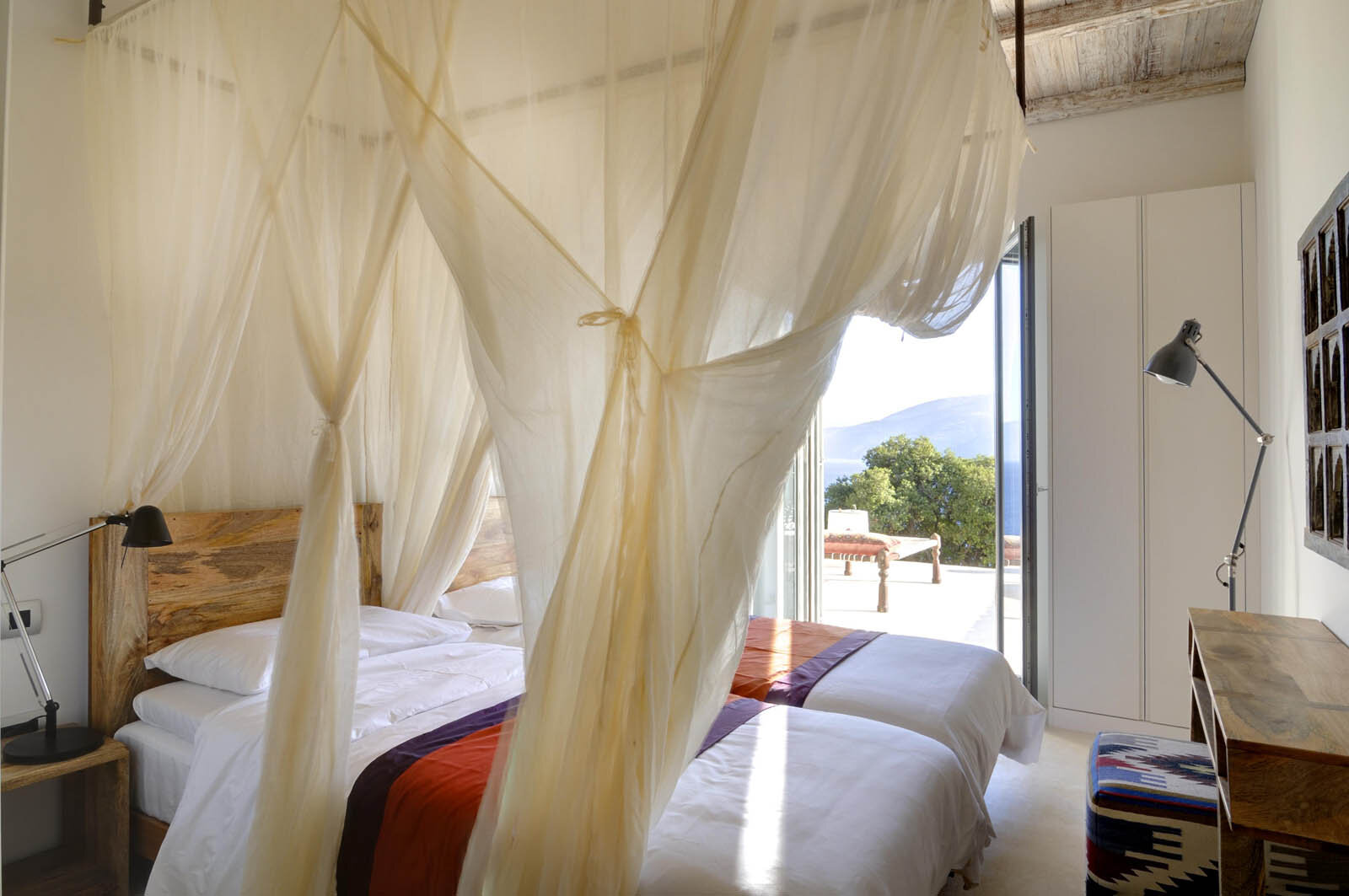 Mango - Shared Twin - $3050 (per person - you'll be paired with another sister in our group)Twin bedroom at the end of the first floor corridor. Includes ensuite bathroom, air conditioning, a balcony with sunbed, and views of the Ionian sea and the hills of Kefalonia.