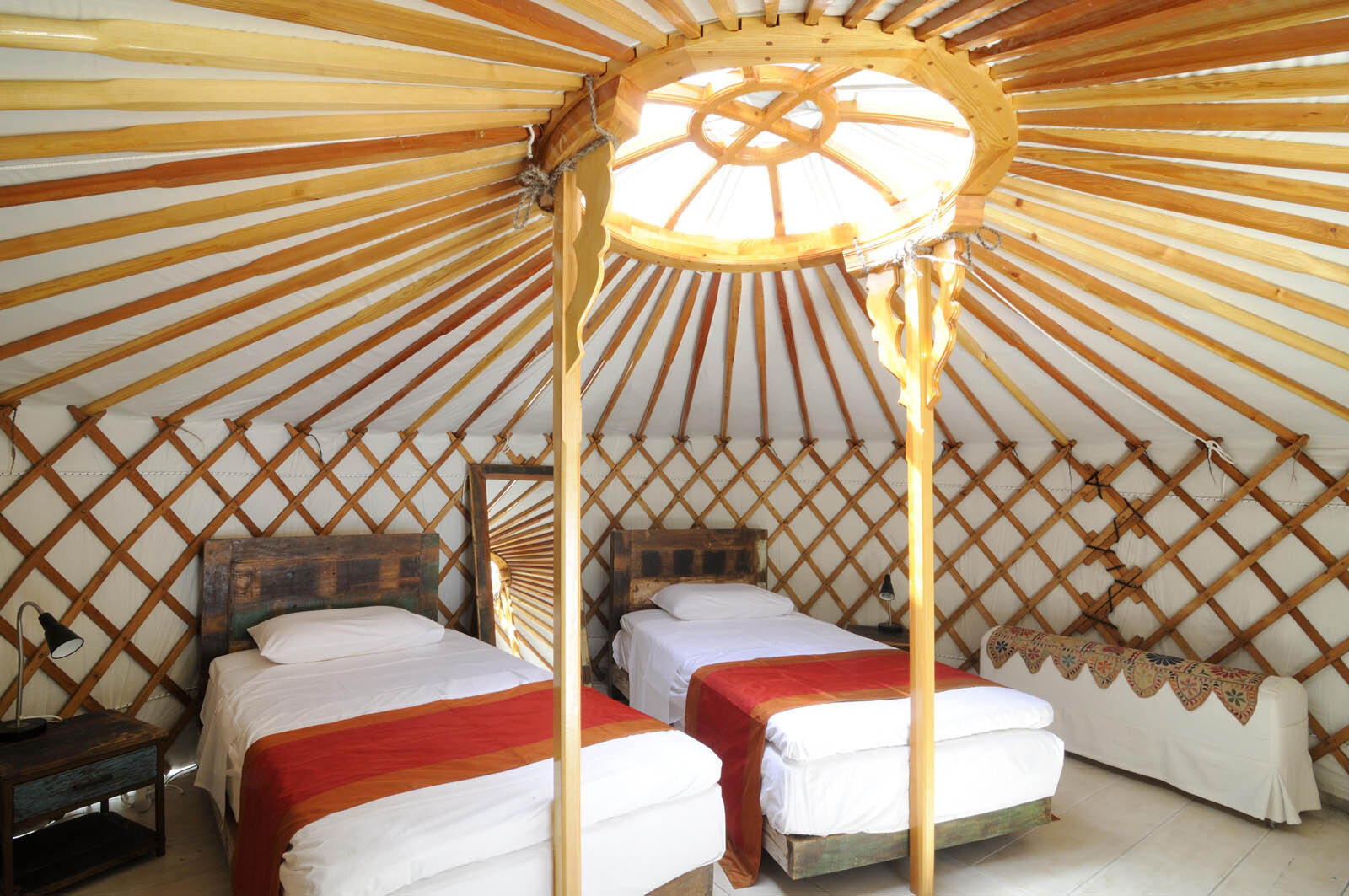 Mongolian Yurt - Shared Twin - $2850 (per person - you'll be paired with another sister in our group)This traditional Mongolian yurt is the nearest one to the outdoor living area, with a removable roof cap built for star gazing. The indoor bathroom with a shower and two wash bowls is semi open planned.