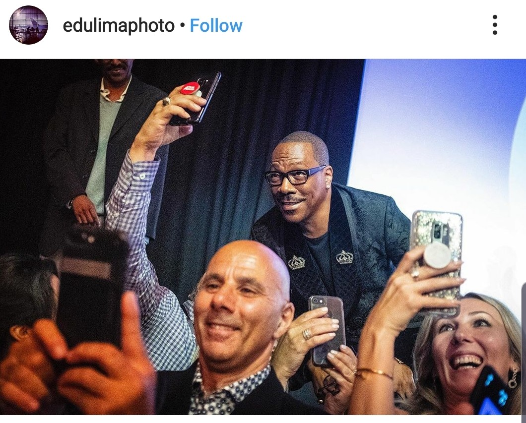 Eddie Murphy taking selfies from the stage. He was seen graciously interacting with reporters, fans, shaking hands and signing autographs.