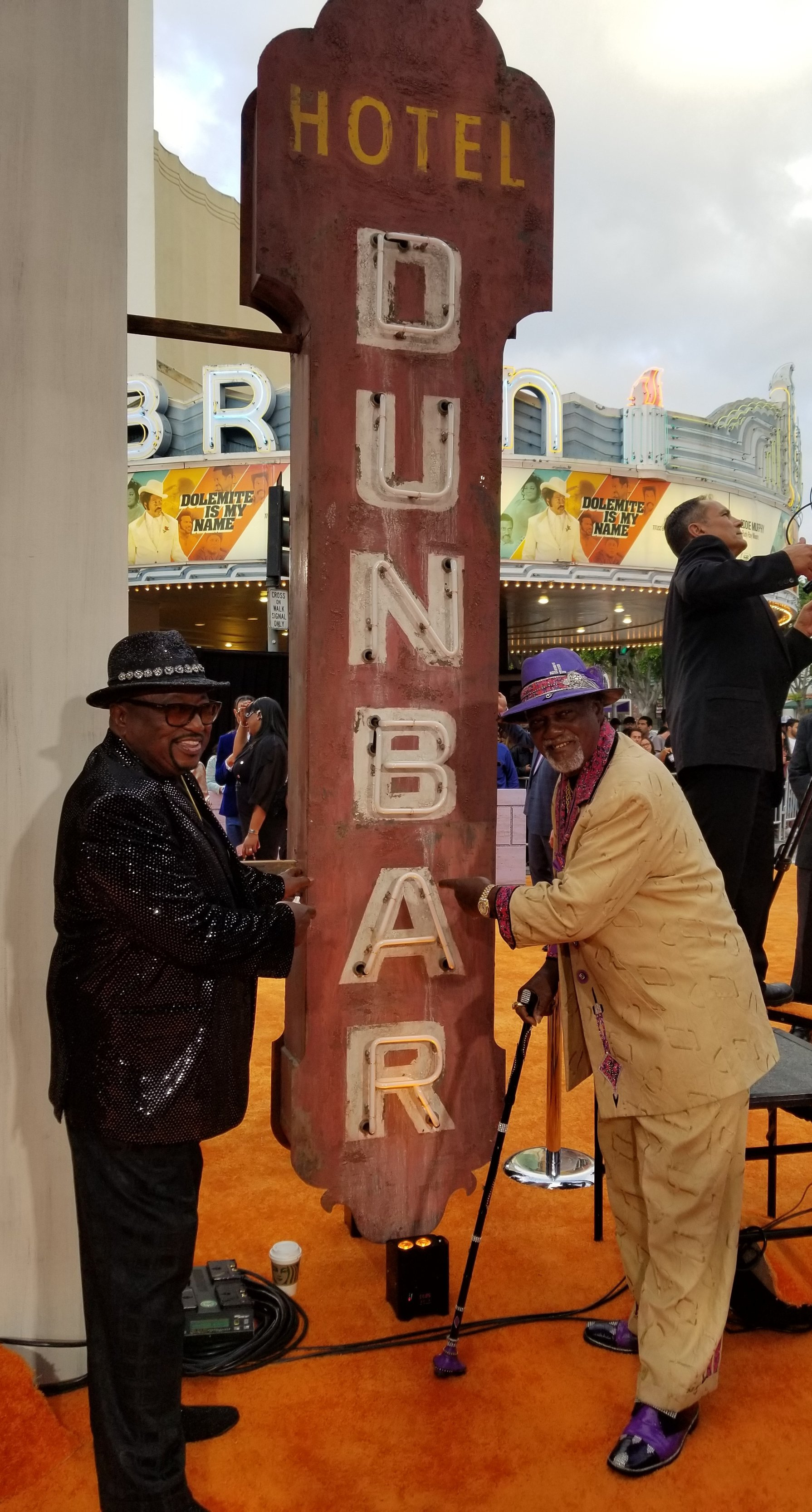 Ben Taylor and Jimmy Lynch in front of the replica sign from the historic Dunbar Hotel.