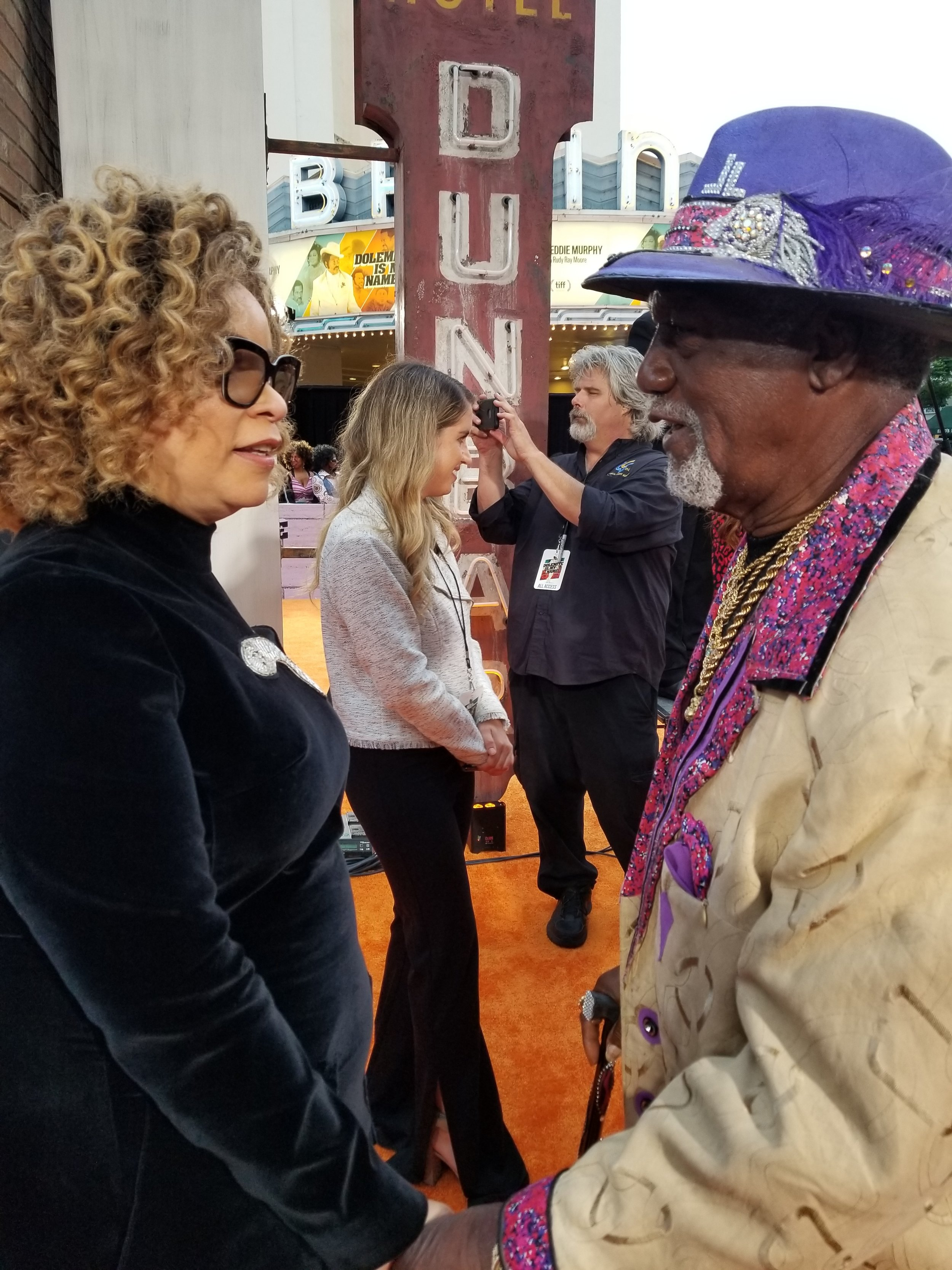 Oscar winner Ruth Carter and Jimmy Lynch discuss the costumes from the film. Lynch created many of the outfits from the original Rudy Ray Moore films.